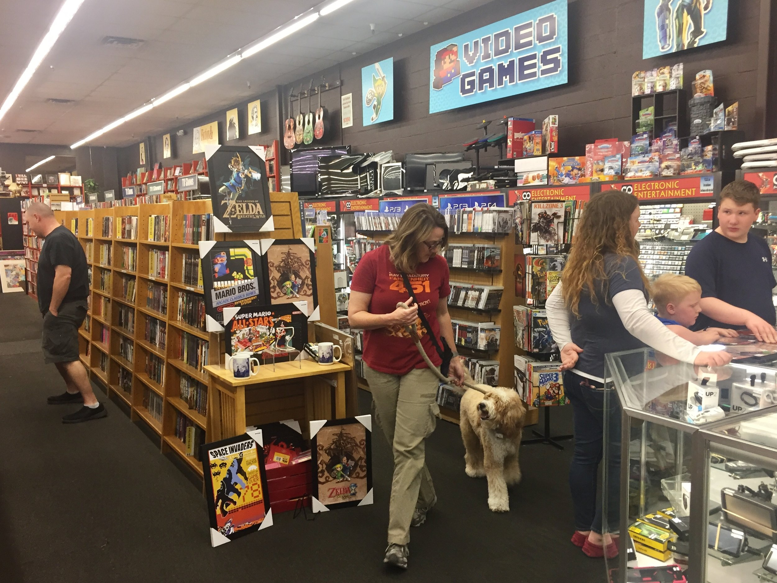Bernie McSquare and I practice walking through crowds at Booksmans Used Bookstore in Tucson, Arizona. This dog-friendly store is one of our regular destinations for practicing CGC skills.