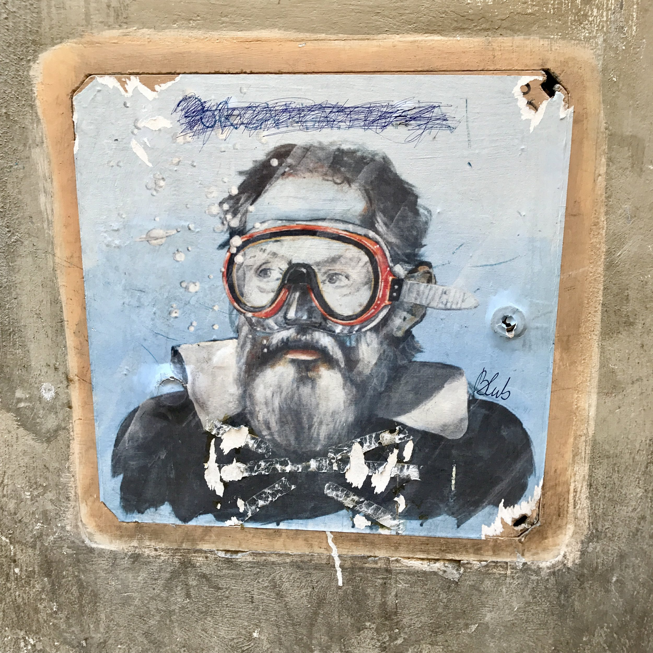 "The Florence, Italy-based street artist  Blub  remixes famous art -- an example is this  portrait of Galileo  ,   As Blub said in a 2017 interview,  ""Renaissance art in Florence is still strong and hides today's art that is alive and contemporary, so by using icons of the past with diving masks the theme presents a mix between the past and the contemporary world. There is no need to deny the past in order to look at the present, but at least acknowledge it.""  With the simple act of blue wash, bubbles, and a snorkling mask, Blub remixes old and new and allows us to see both!"