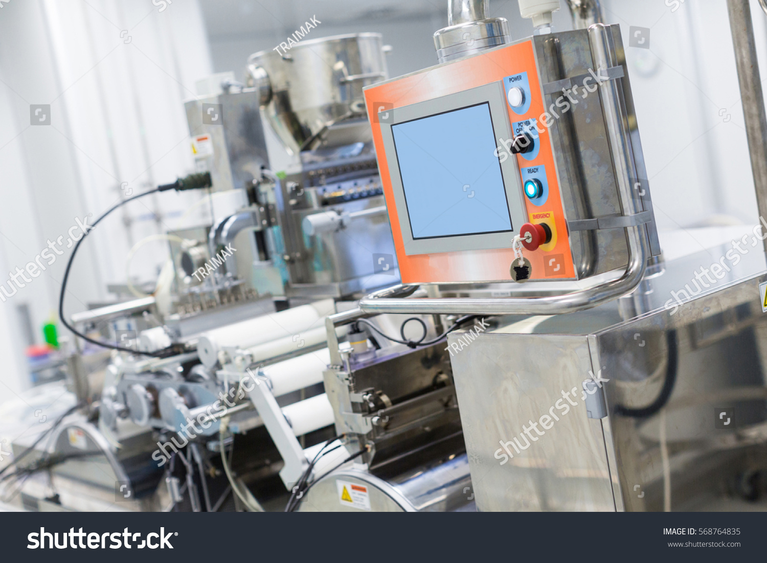 stock-photo-big-manufacture-machine-with-shafts-and-control-panel-568764835.jpg