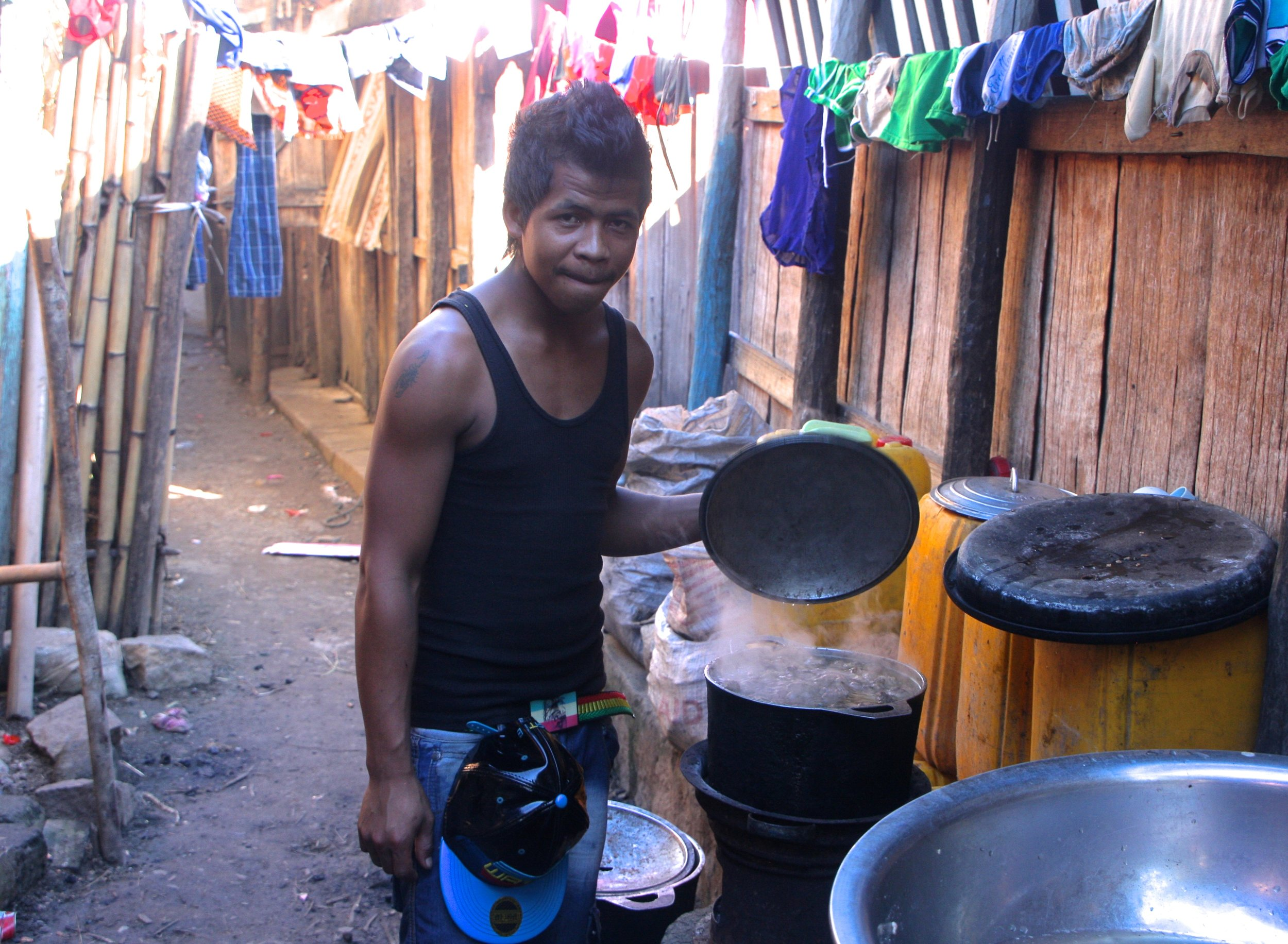 Cooking lunch over a wood stove in Kianjavato.
