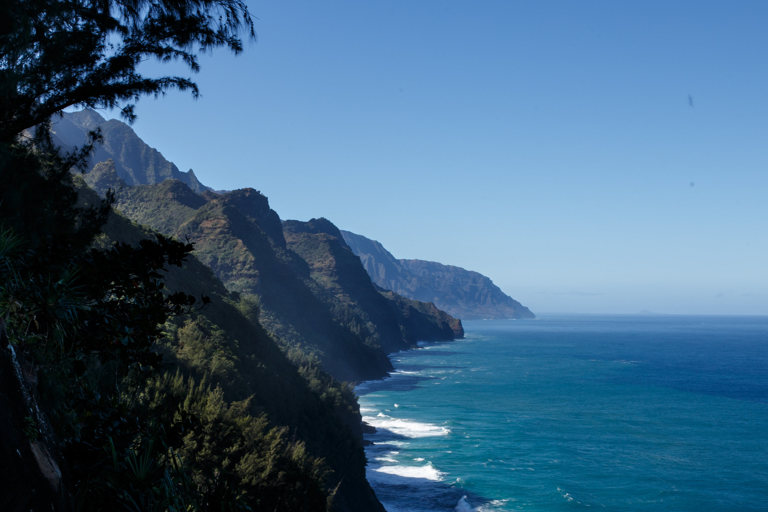 Peering out at the switchbacks and cliffs to come against a clear Hawaiian sky and calm ocean waters.