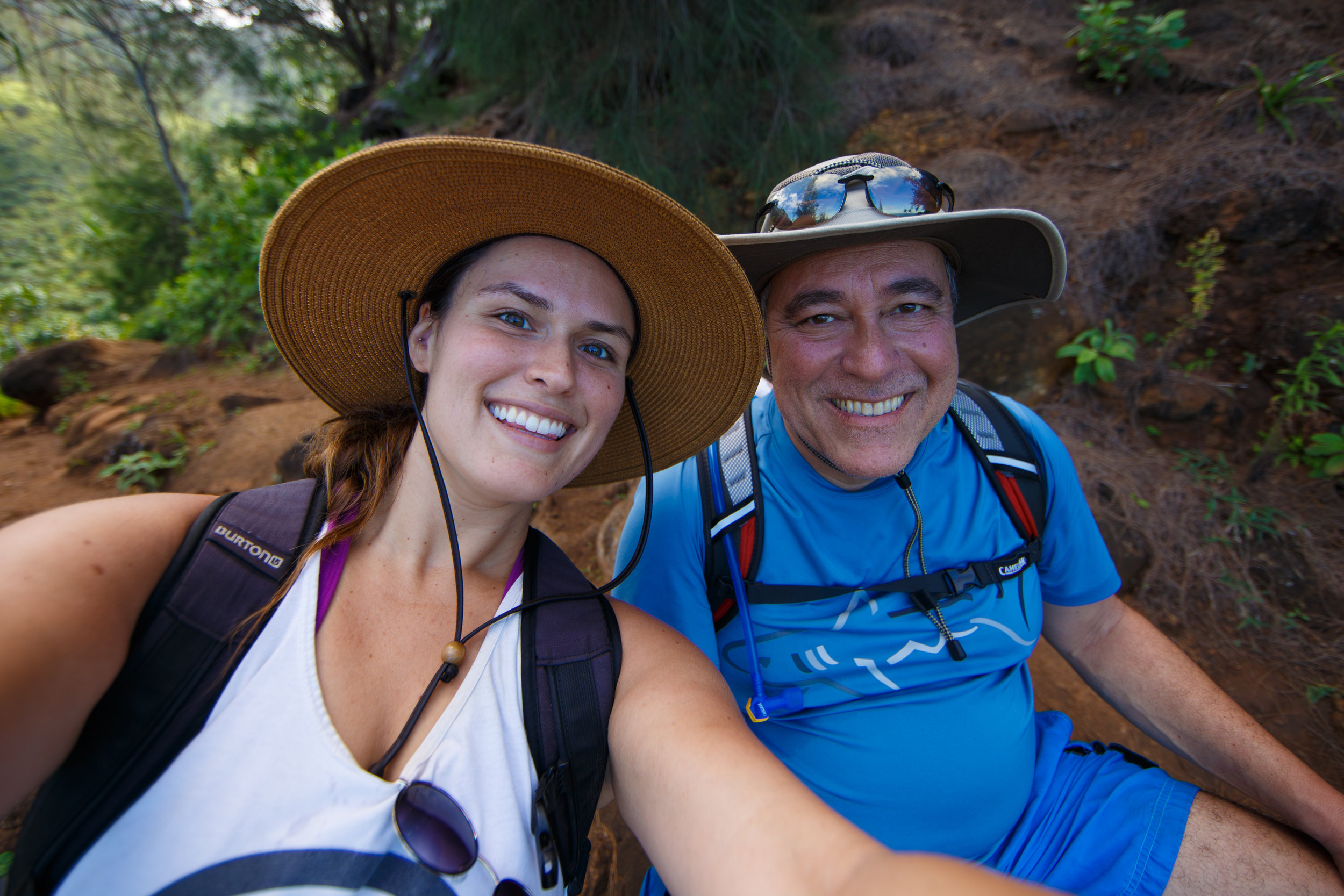 A quick snap of the happy hikers resting on a rock along the trail.