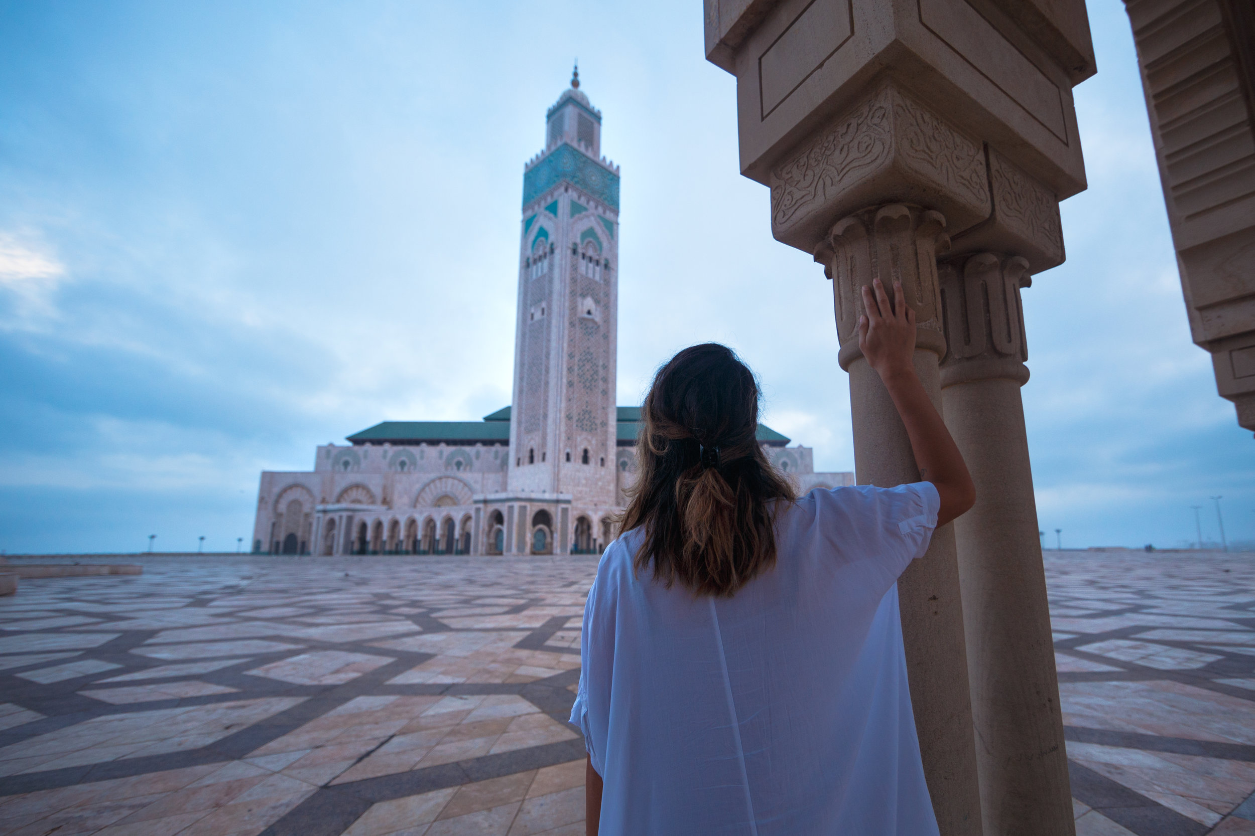 The sun rising above Hassan II Mosque in Casablanca.