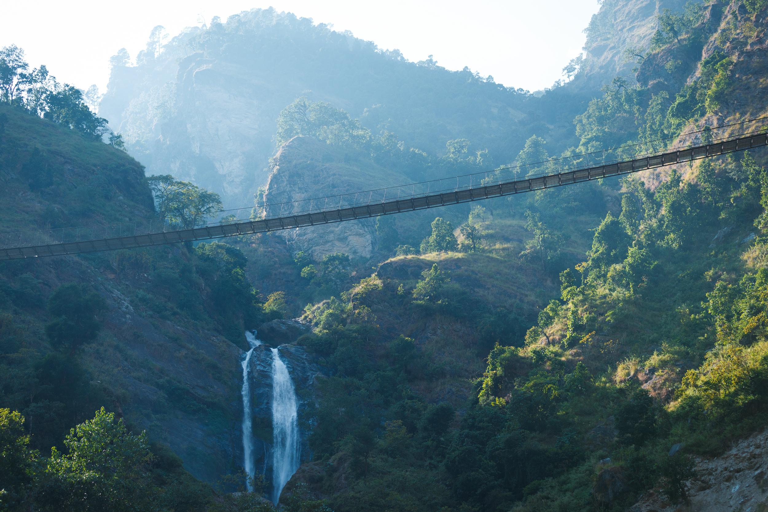 Suspension bridges criss-cross over rivers and valleys below.