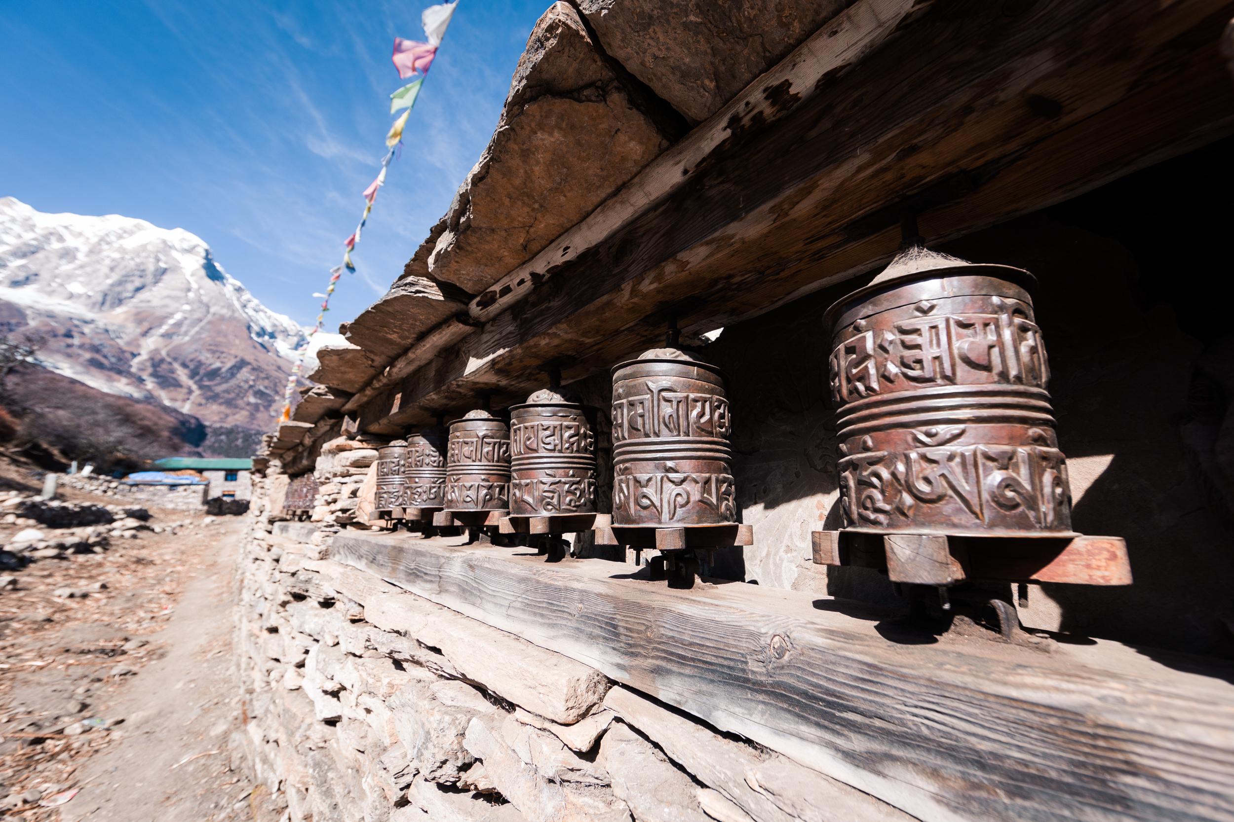Buddhist prayer wheels coming into the village of Samagaun.
