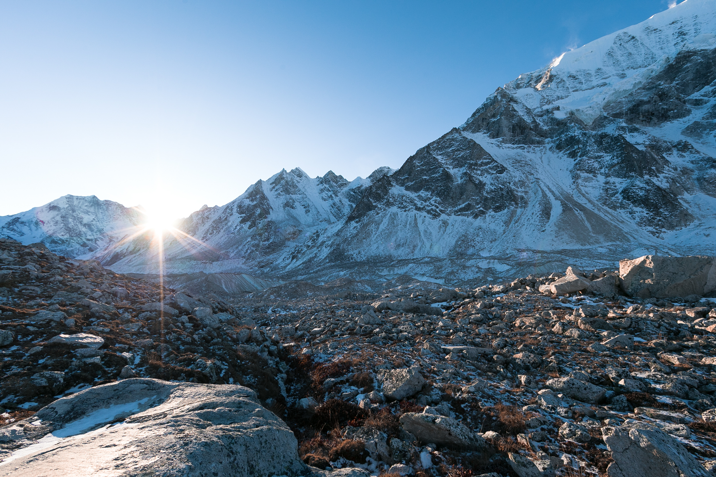 The frozen rocky landscape.