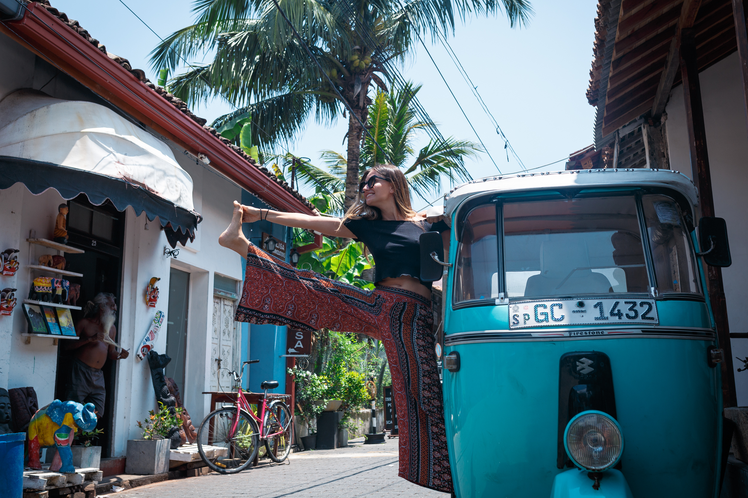 Adzenture co-founder, Daniela, striking a pose out of a tuk-tuk at Galle Fort.