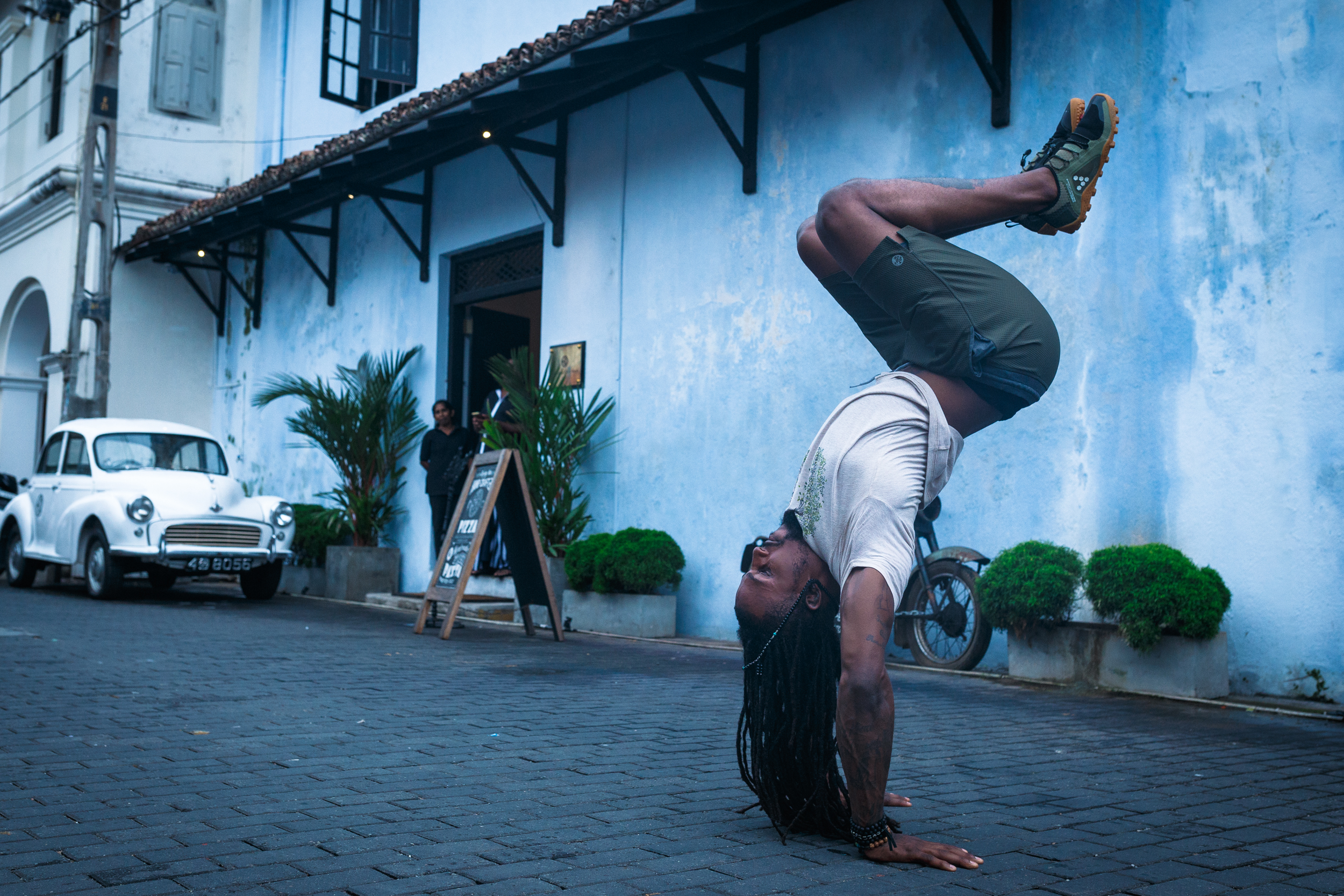 DJ in a handstand on the streets of Galle Fort.