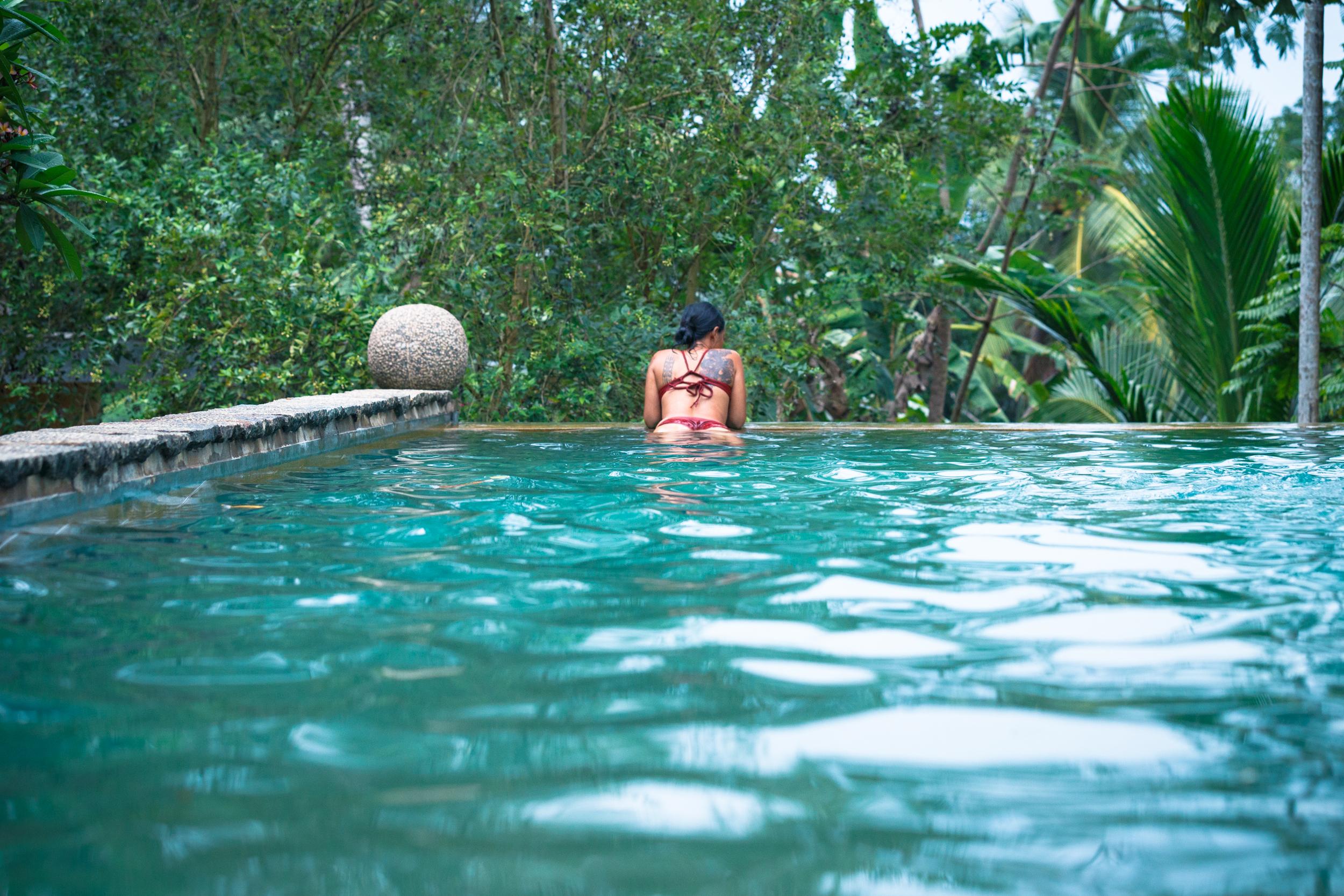 Enjoying the infinity pool in the jungle at Sri Yoga Shala.