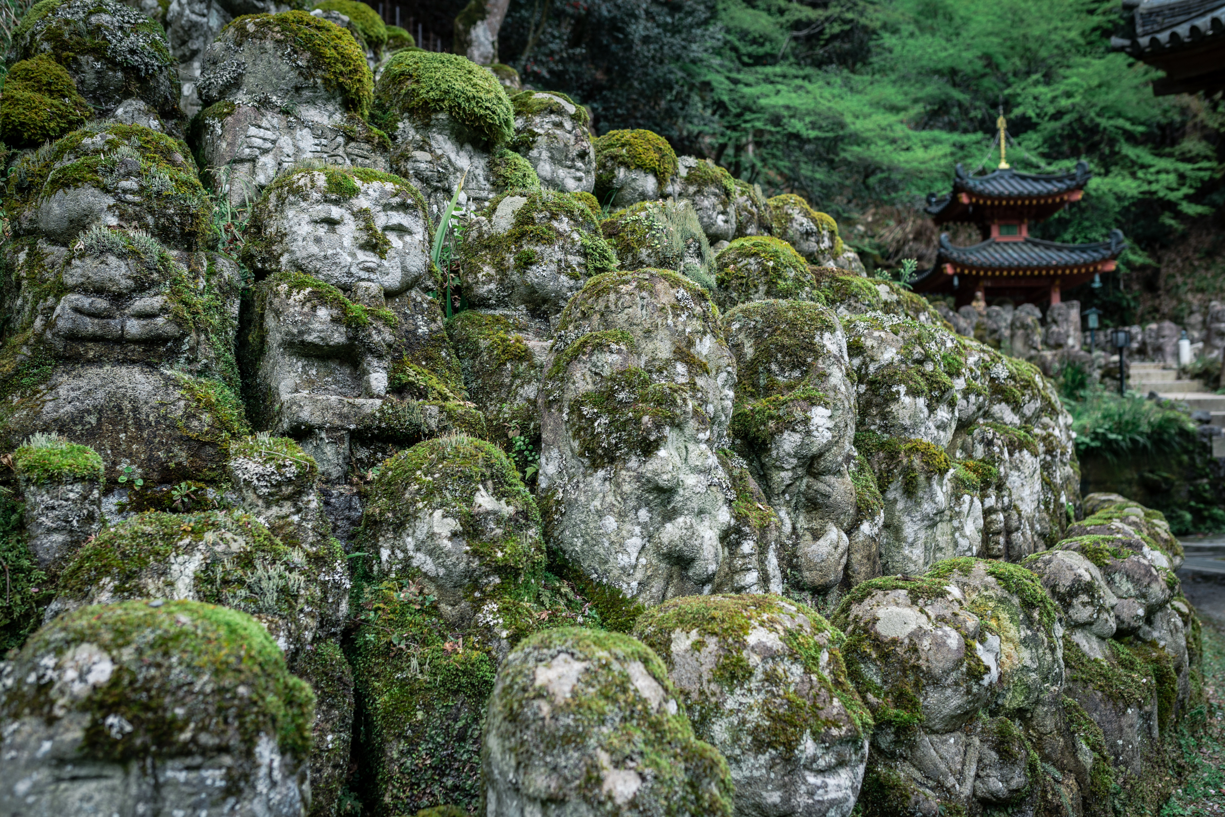 Walls of moss-covered statues stretch between the temples.