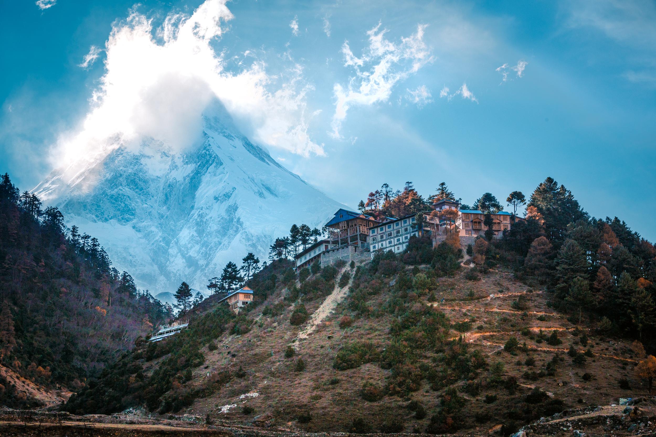 Mt. Manaslu (8,106m) smoking above the village of Lho.