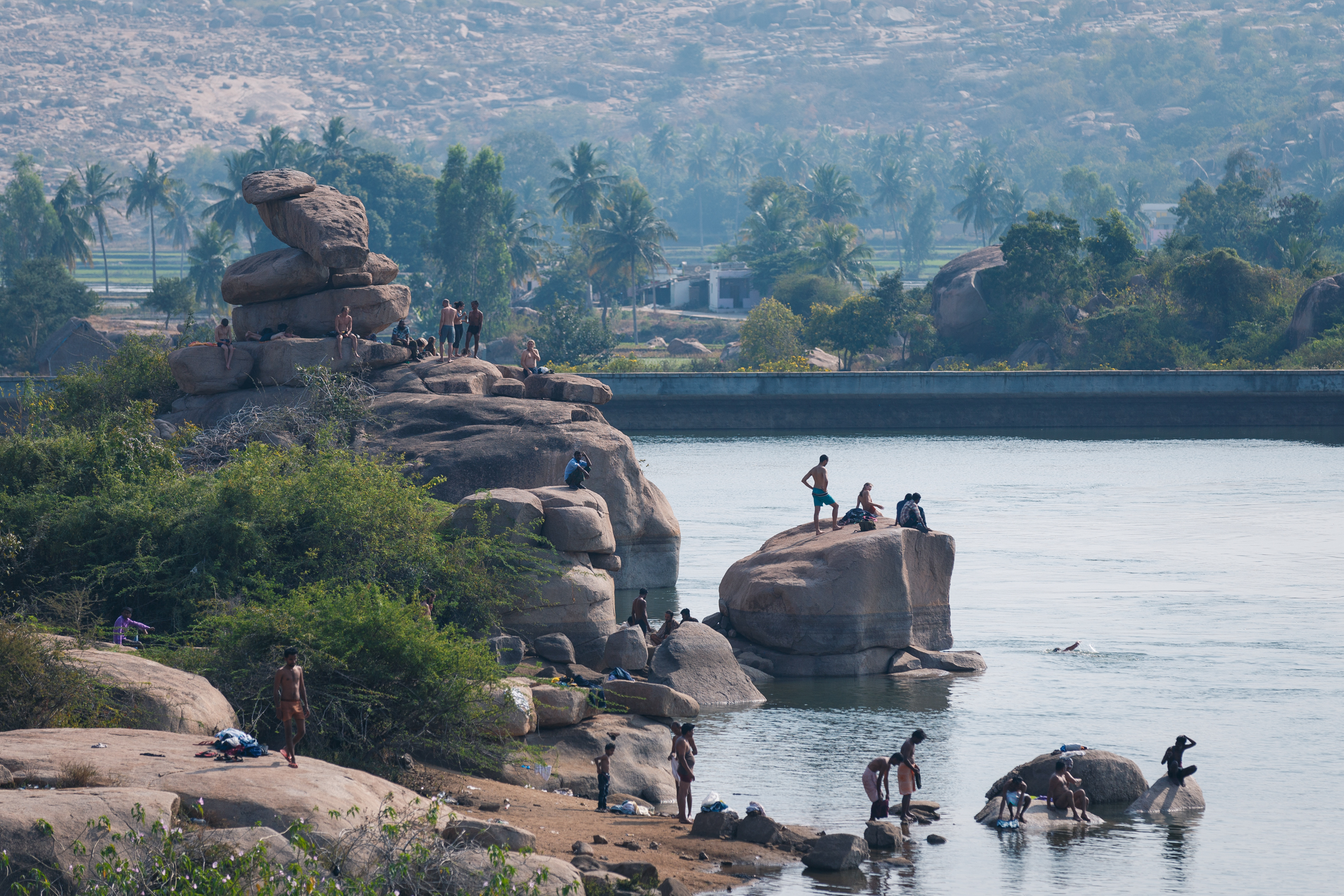 Lounge on the rocks and jump off the boulders for a refreshing swim at Sanapur Lake.