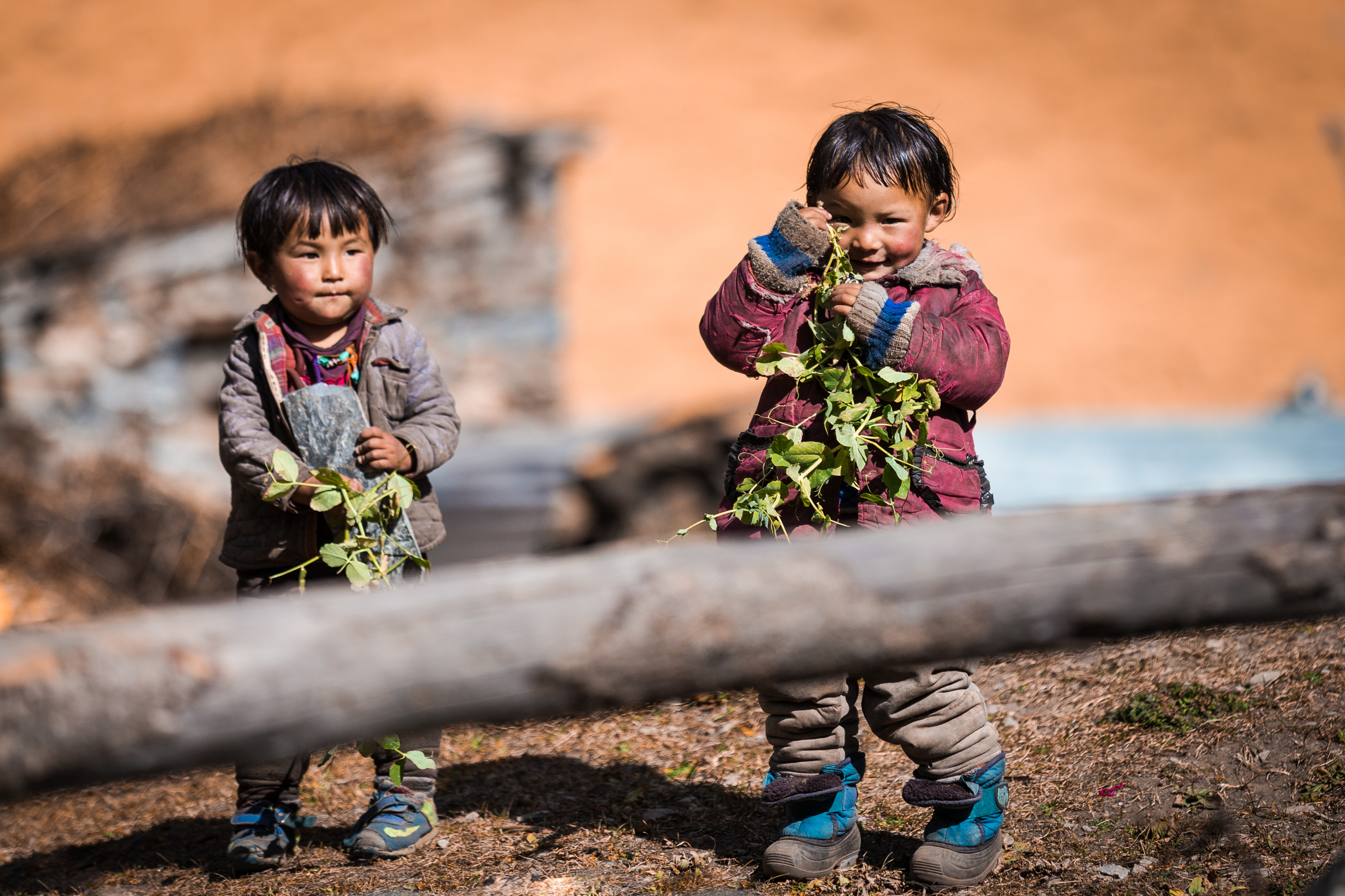Children playing in a village in Tsum Valley. The people of Nepal are kind and generous with trekkers.