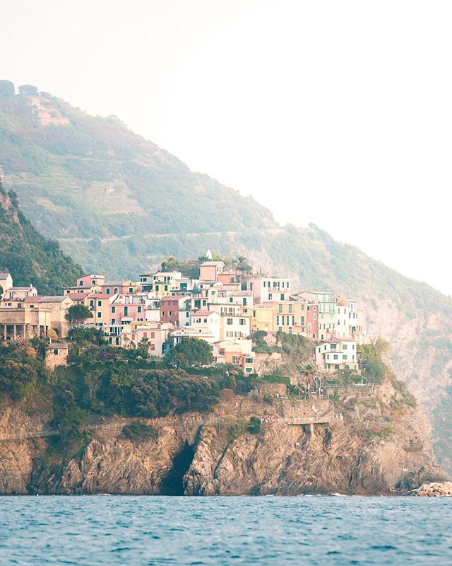 The Cinque Terre is a series of five colorful villages nestled into small harbors and perched on the steep  cliffs that characterize this section of the Italian Riviera.  Hands down, this is one of my favorite places on the planet and is worth spending a couple days to explore and enjoy.  Do hike the Sentiero Azzurro that traverses the cliffside between the towns, through small vineyards that have been maintained for centuries.  If you've got some cash to spend, take a sunset boat ride from Rio Maggiore to see the five towns from the ocean, lit with the colors of the setting sun. . . . . . #KelsieDiPernaPhoto FindYourAdventure #CinqueTerre #Italy #WomenWhoExplore #NatGeoTravel #RoughGuides #TheGreatOutdoors #SpeechlessPlaces #FindItLiveIt #FolkGreen #LiveUnscripted #RoamEarth #WonderMore #ExploreOurEarth #TheOutbound #EarthOutdoors #StayAndWander #FolkScenery #RoamThePlanet #LifeOfAdventure #DepthsOfEarth #ExploreToCreate #VisualLife #CreateExplore #TravelAwesome #NatGeoAdventure #WanderTheWorld #AGameOf10k #TheImaged