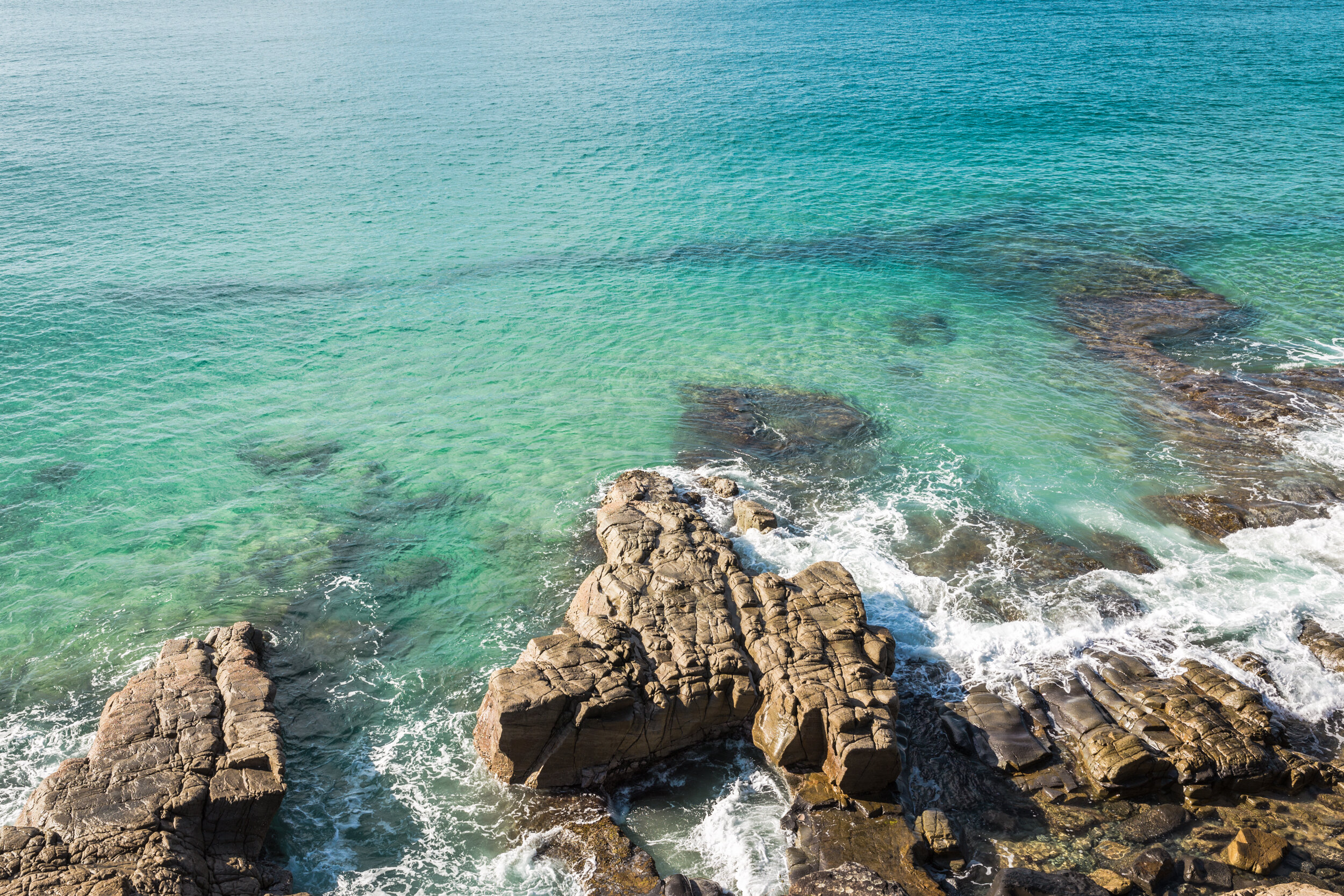 Colorful coastline at the Boiling Pot in Noosa National Park.