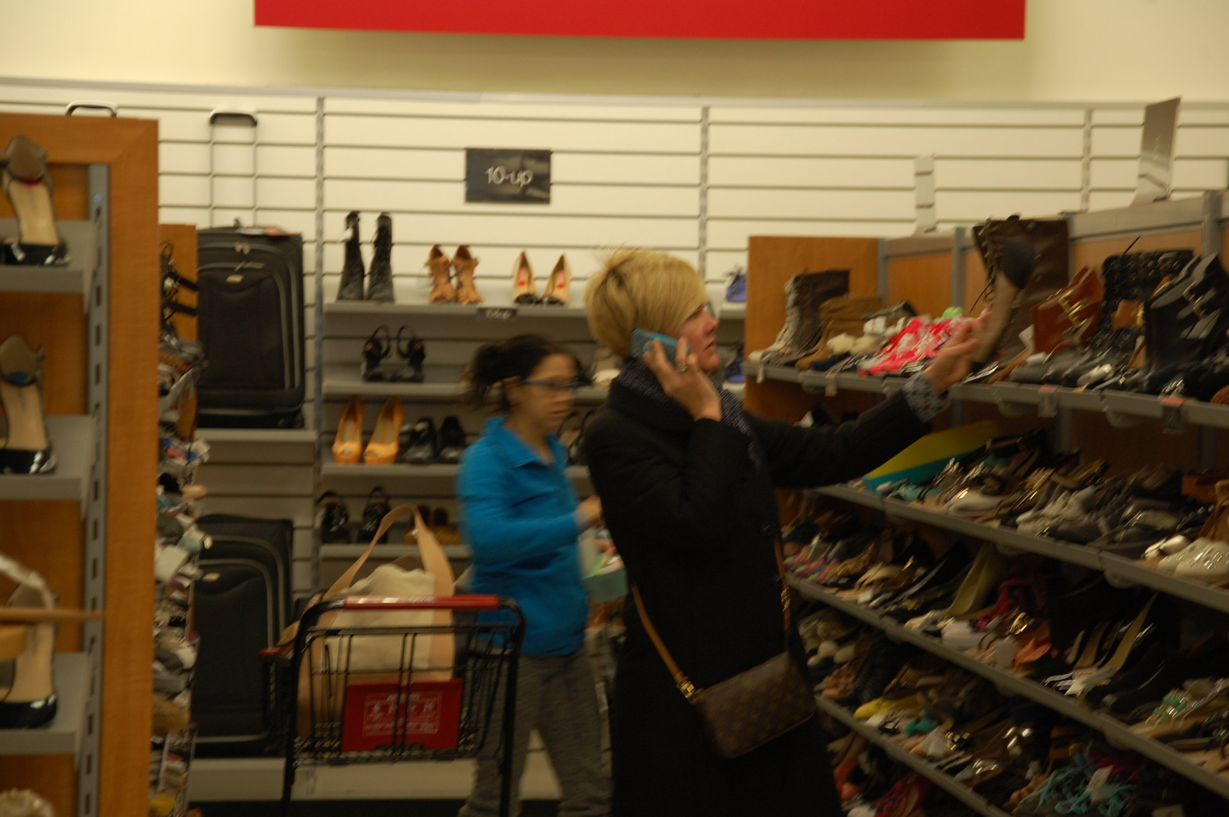 A shopper considers a pair of shoes. Will she take it home?