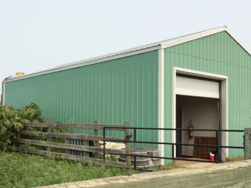 The insulated shop at the Johnson site with overhead door, office and washroom
