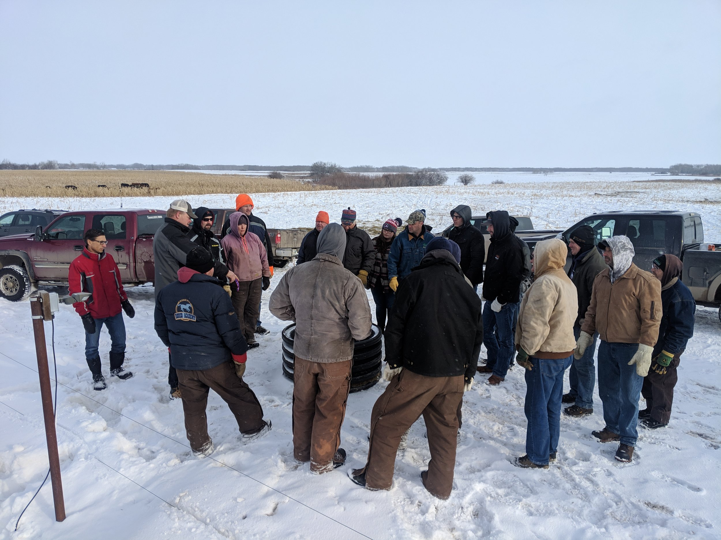 Winter Workshop tour participants looking at the MBFI solar powered motion sensored winter watering system 2018