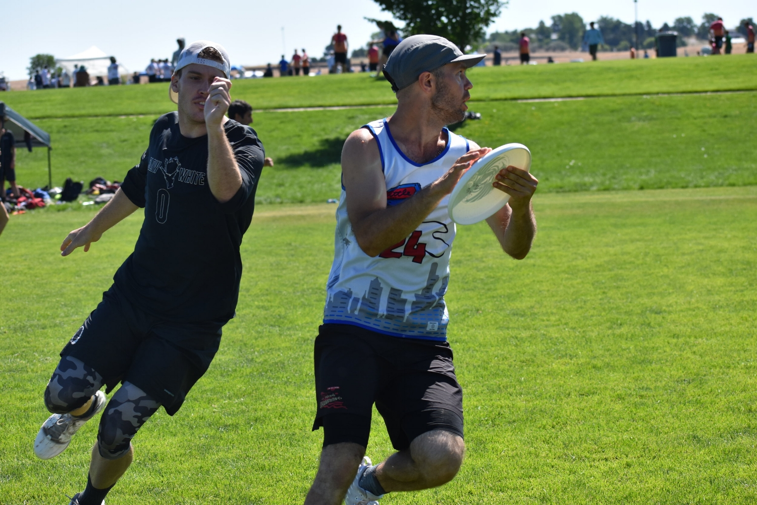 Alex Duffel of Seattle Mixtape catches the disc in front of Boston Slow White's Walker Hatchett. (Laurel Oldershaw)