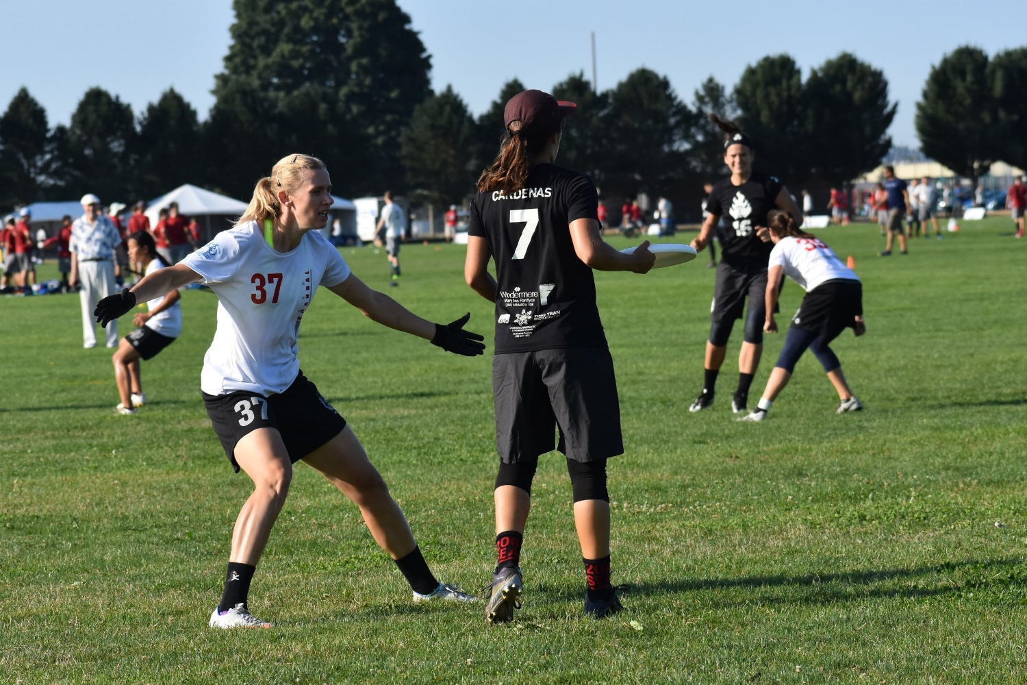 Calise Cardenas of  Seattle Riot  matches up against  Washington DC Scandal 's Sandy Jorgensen in pool play at USAU Pro Championships. (Laurel Oldershaw)