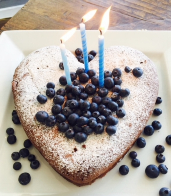 Nigella Lawson's Flourless Chocolate Cake, sprinkled with blueberries an icing sugar
