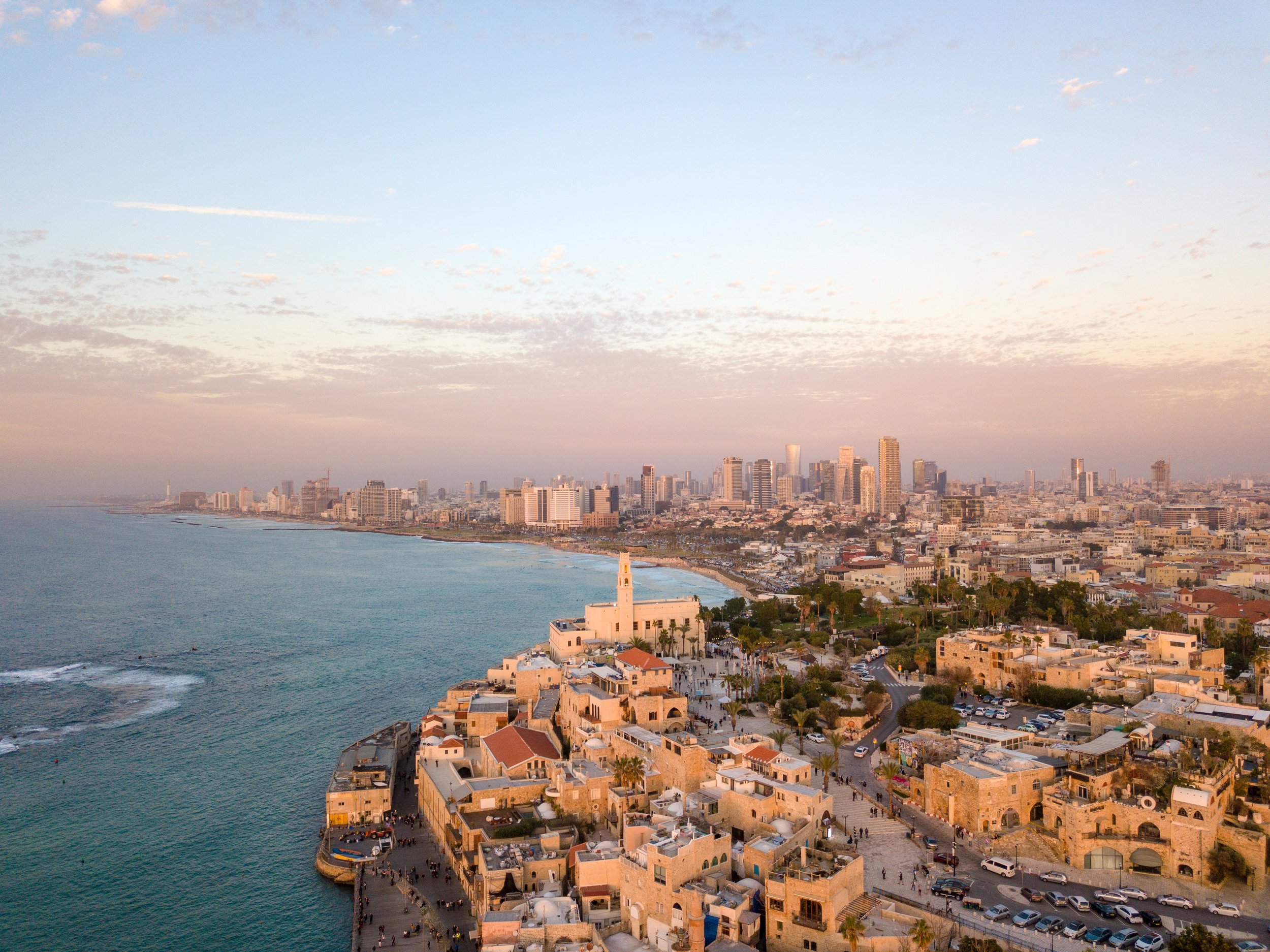 sunset aerial view of tel aviv on the water.jpg