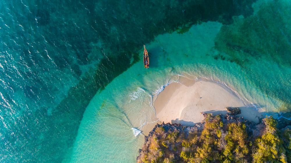 wooden boat on an island shore in zanzibar tanzania