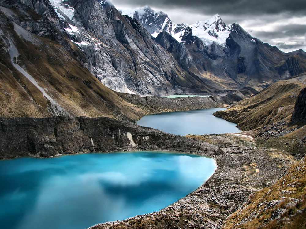 turquoise lakes and towering snow-covered peaks