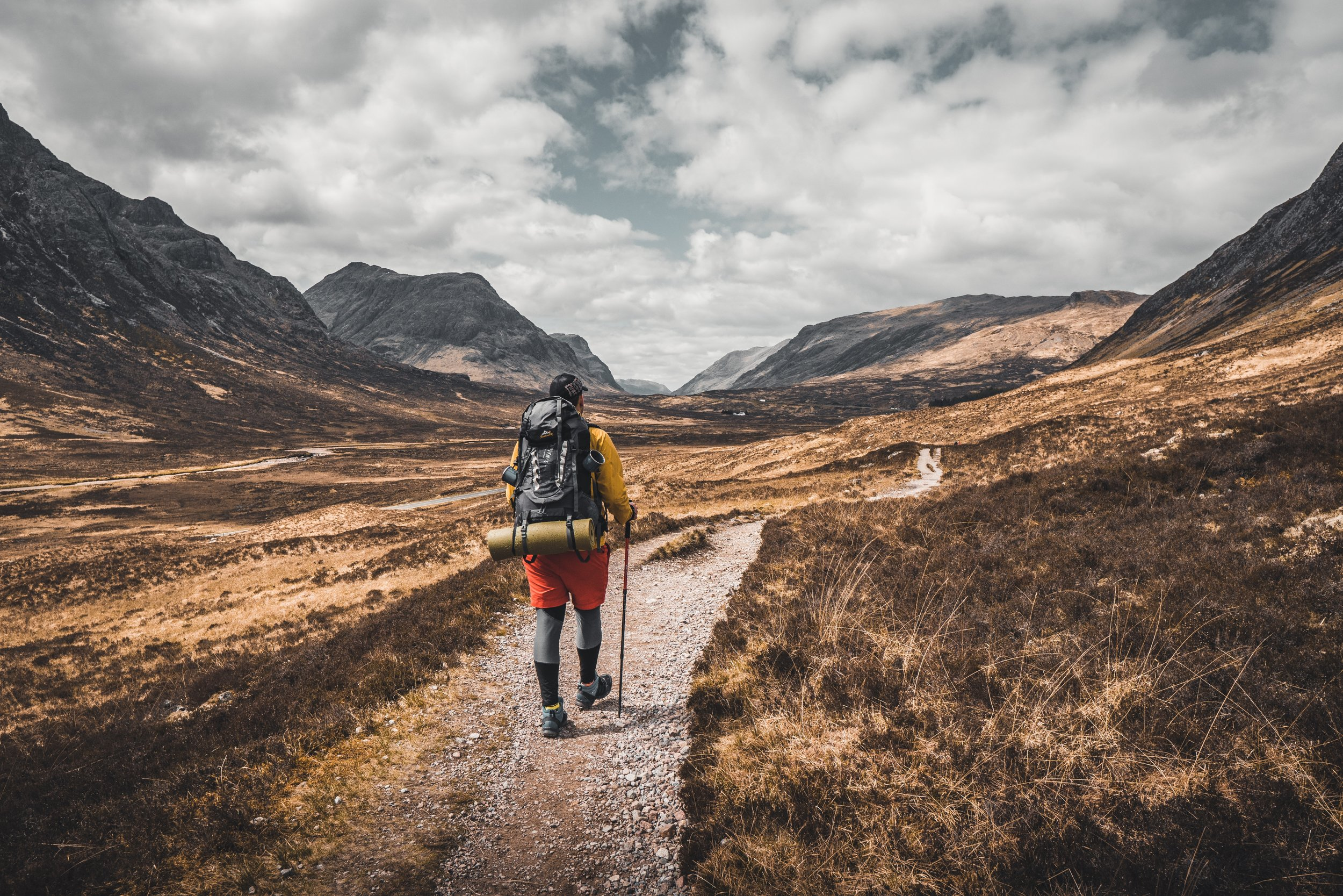 man trekking through the way of st andrews in scotland in the mountains.jpg