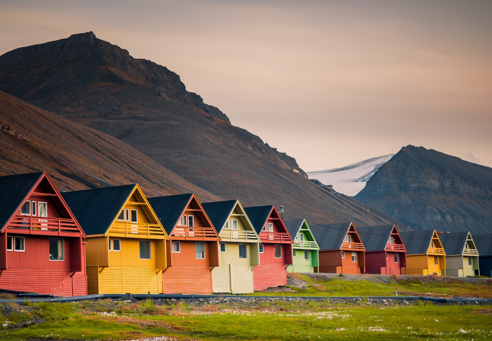 colored houses in norway among the mountains.jpg