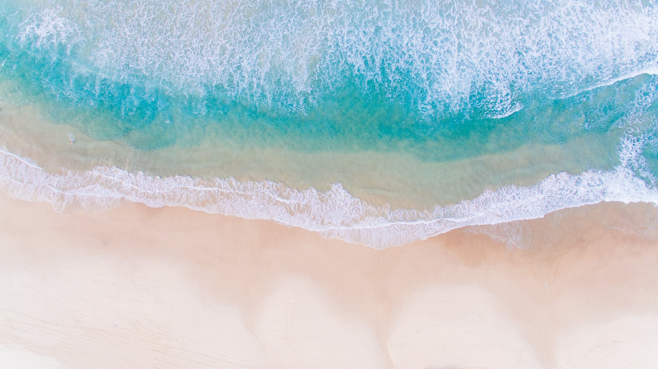 aerial view of turquoise water and white sands