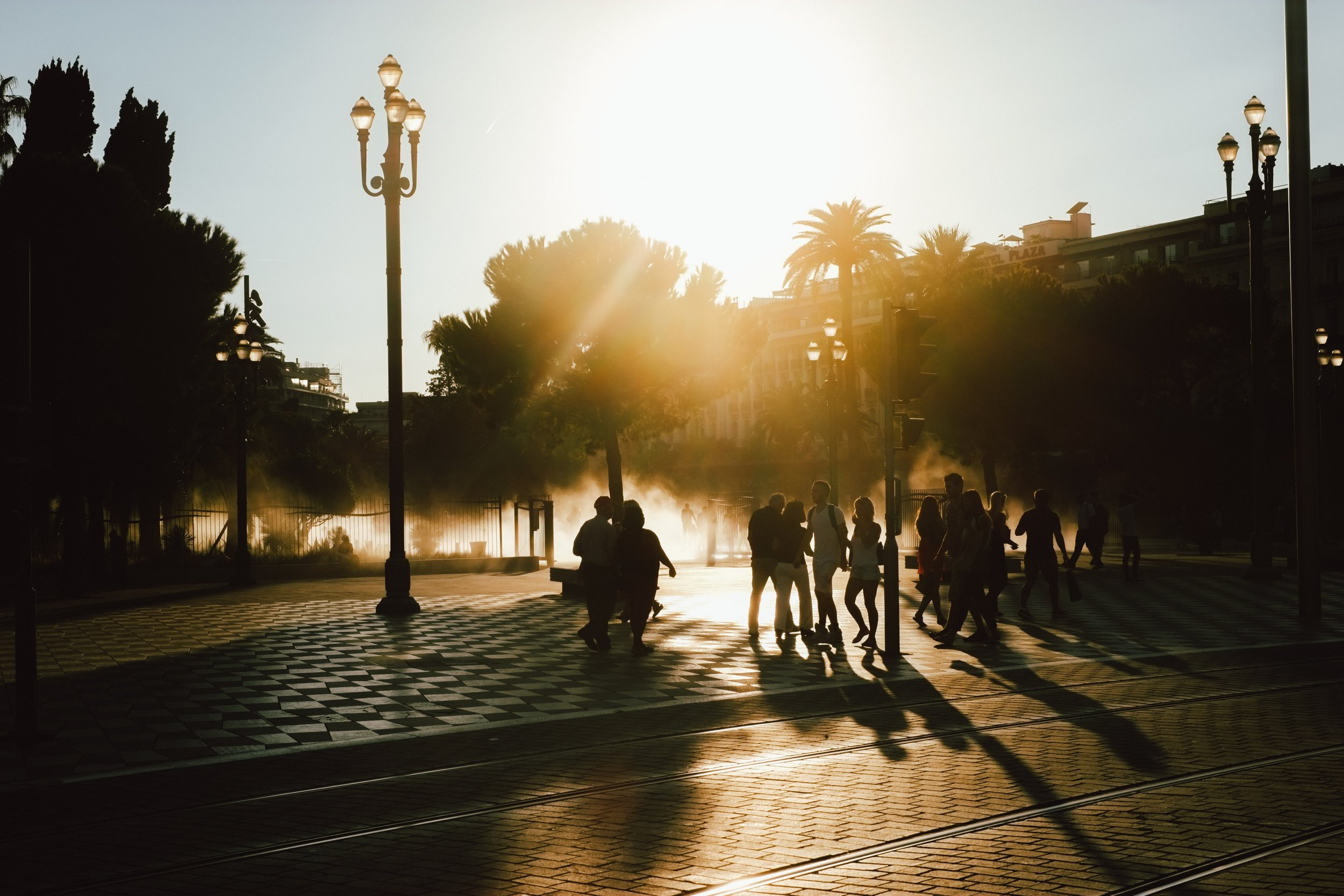 shadows of people on the street at sunset
