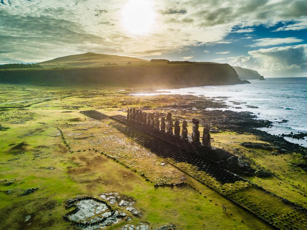 moai next to the ocean on green land