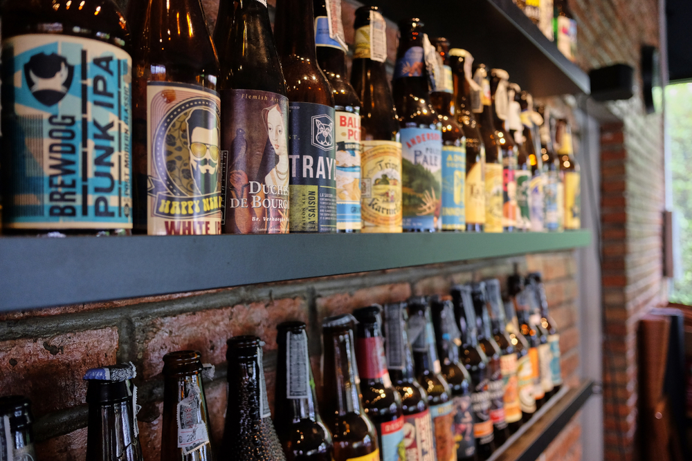 craft beers stacked on shelves