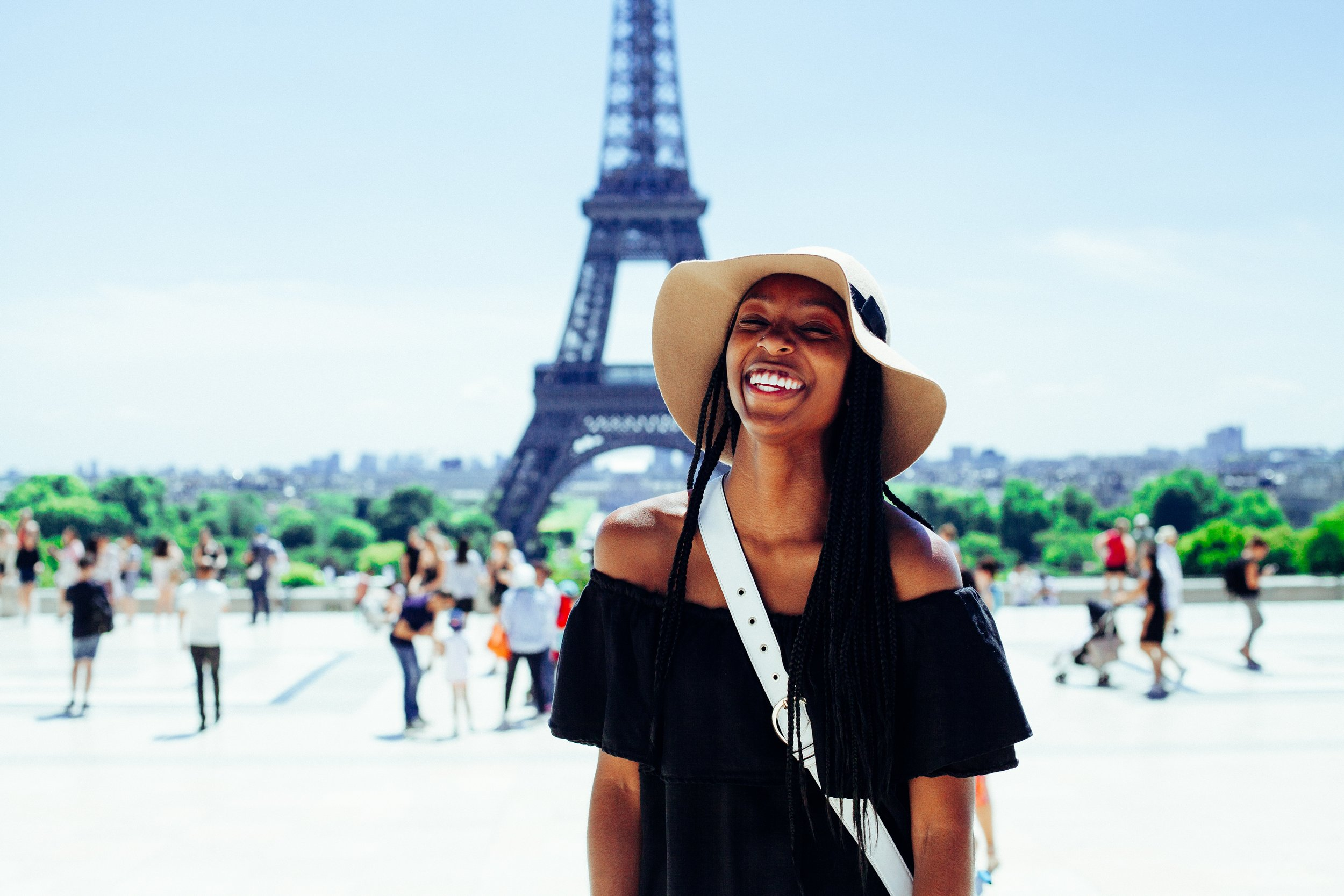 smiling woman in front of the eiffel tower