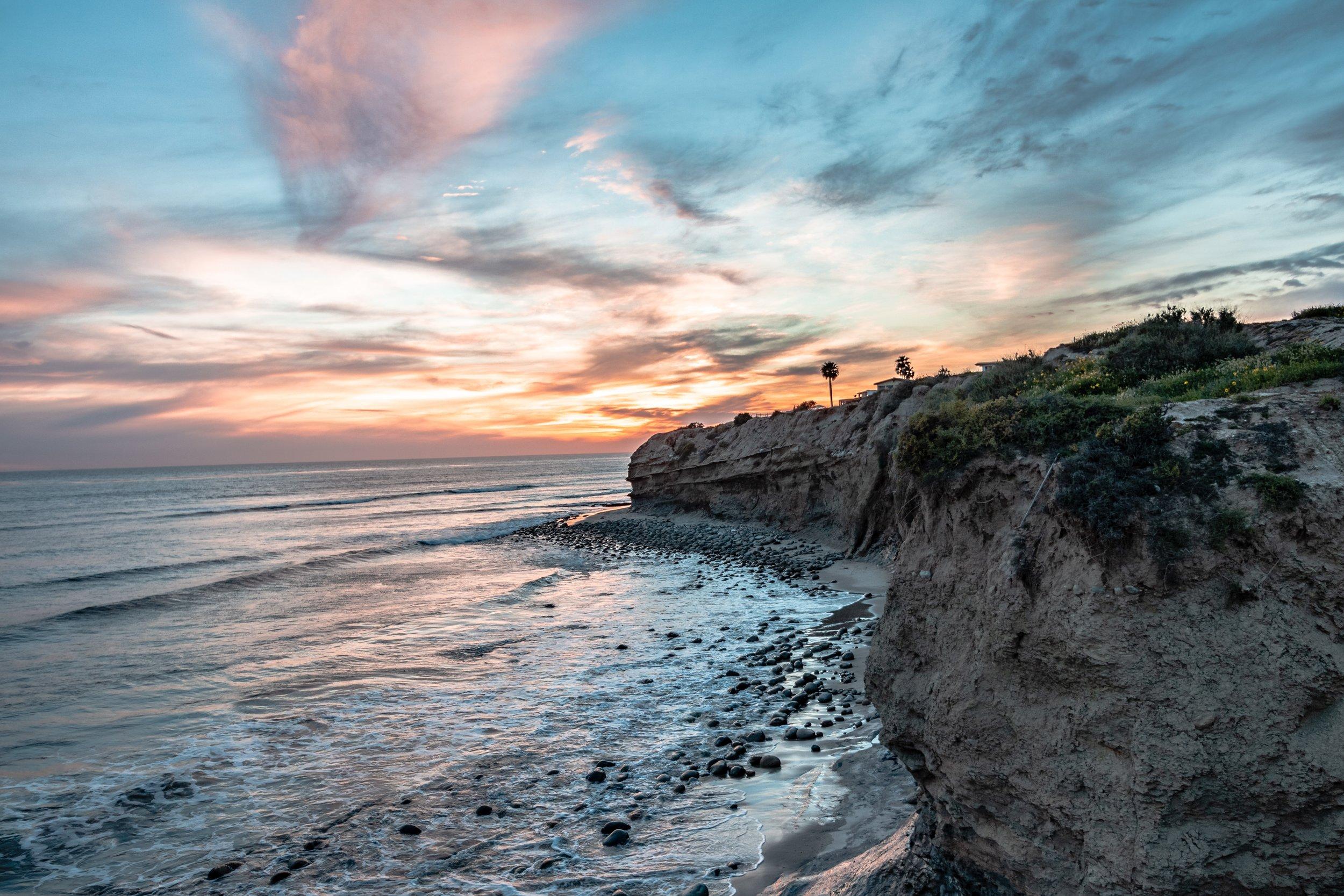 rocky beach on the baja coast at sunset