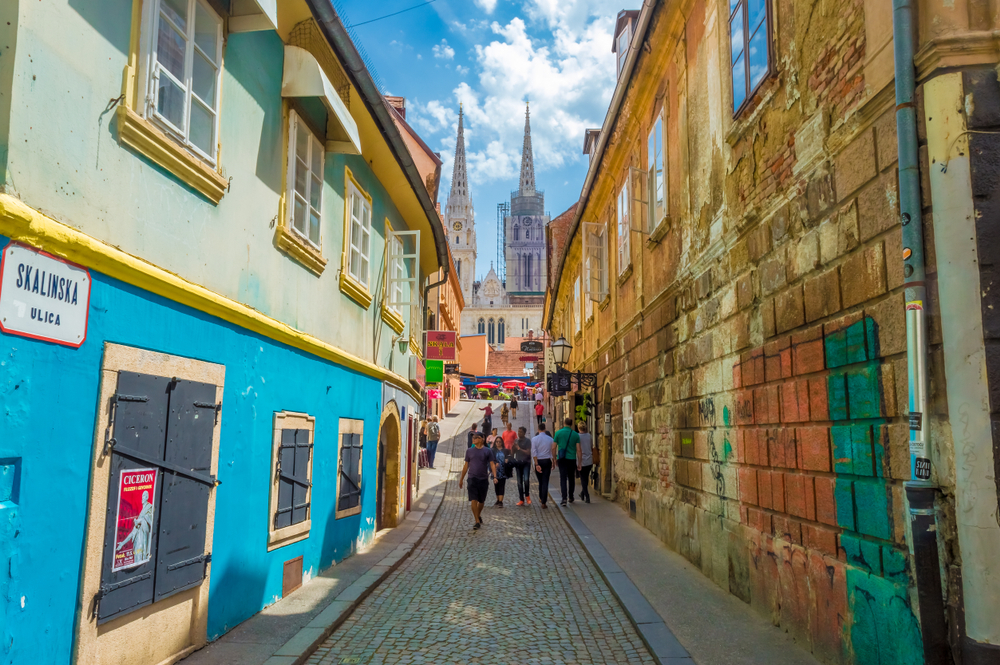 colorful street in zagreb croatia with basilica in the background