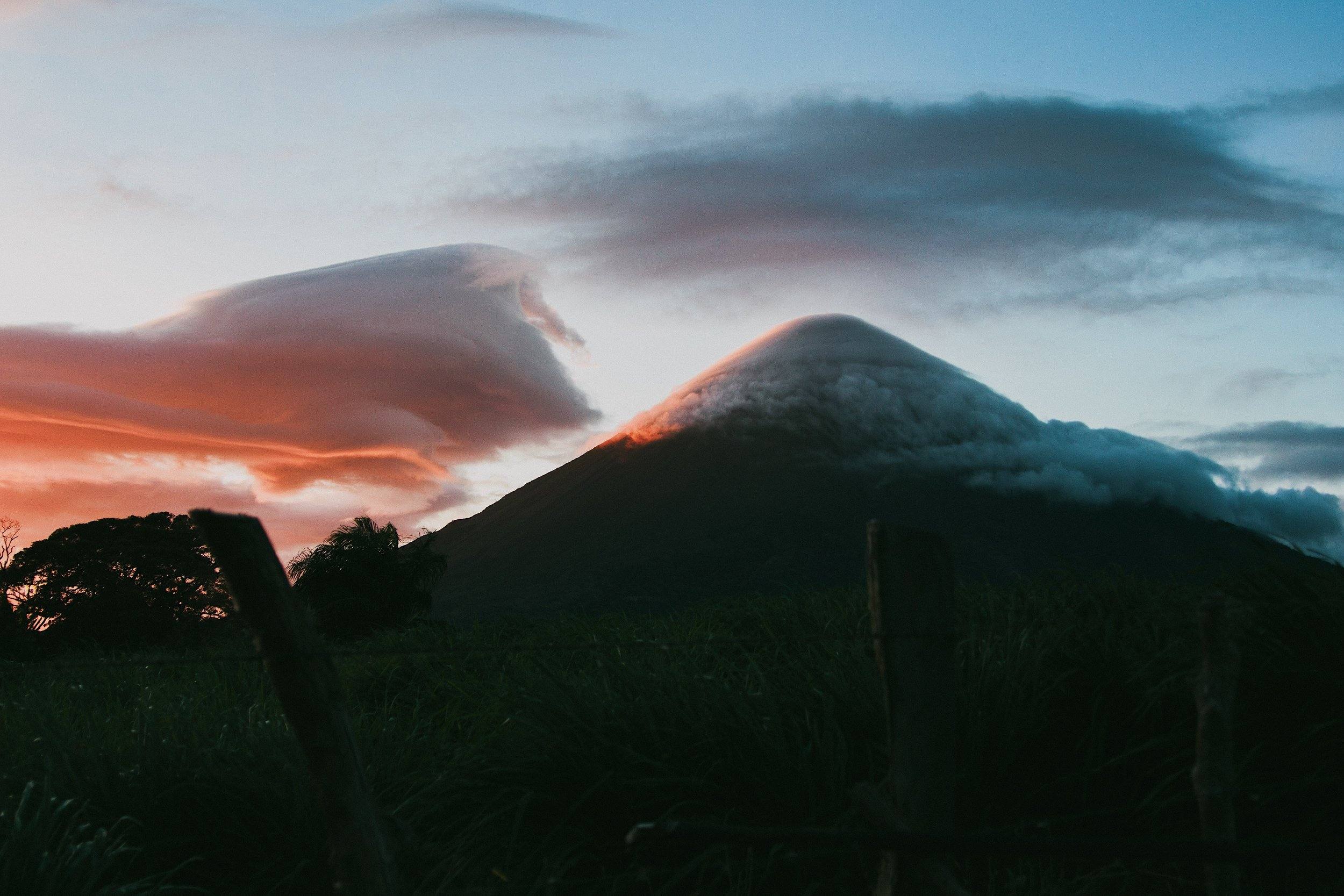 volcano at sunrise surrounded by clouds in Nicaragua