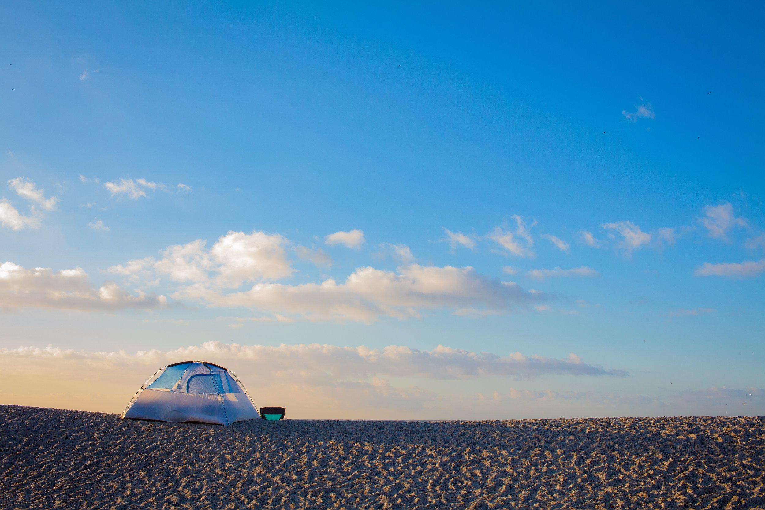 tent on the sand at sunset