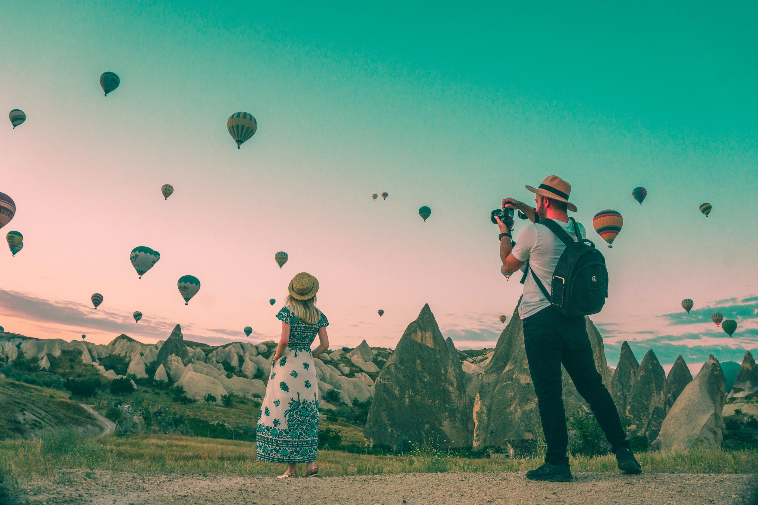 couple photographer hot air-balloons in cappadocia at sunrise