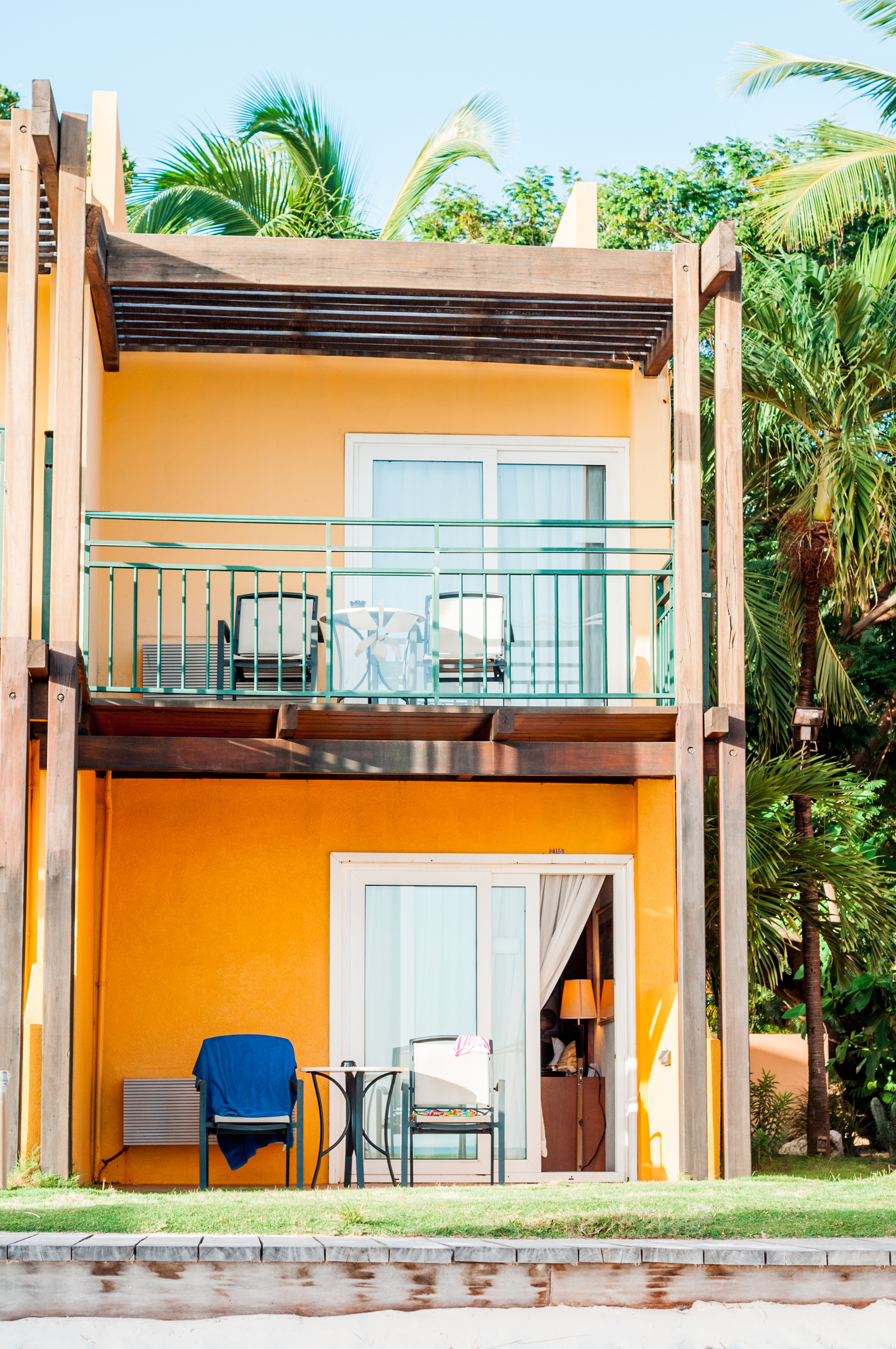 bright orange airbnb surrounded by palm trees