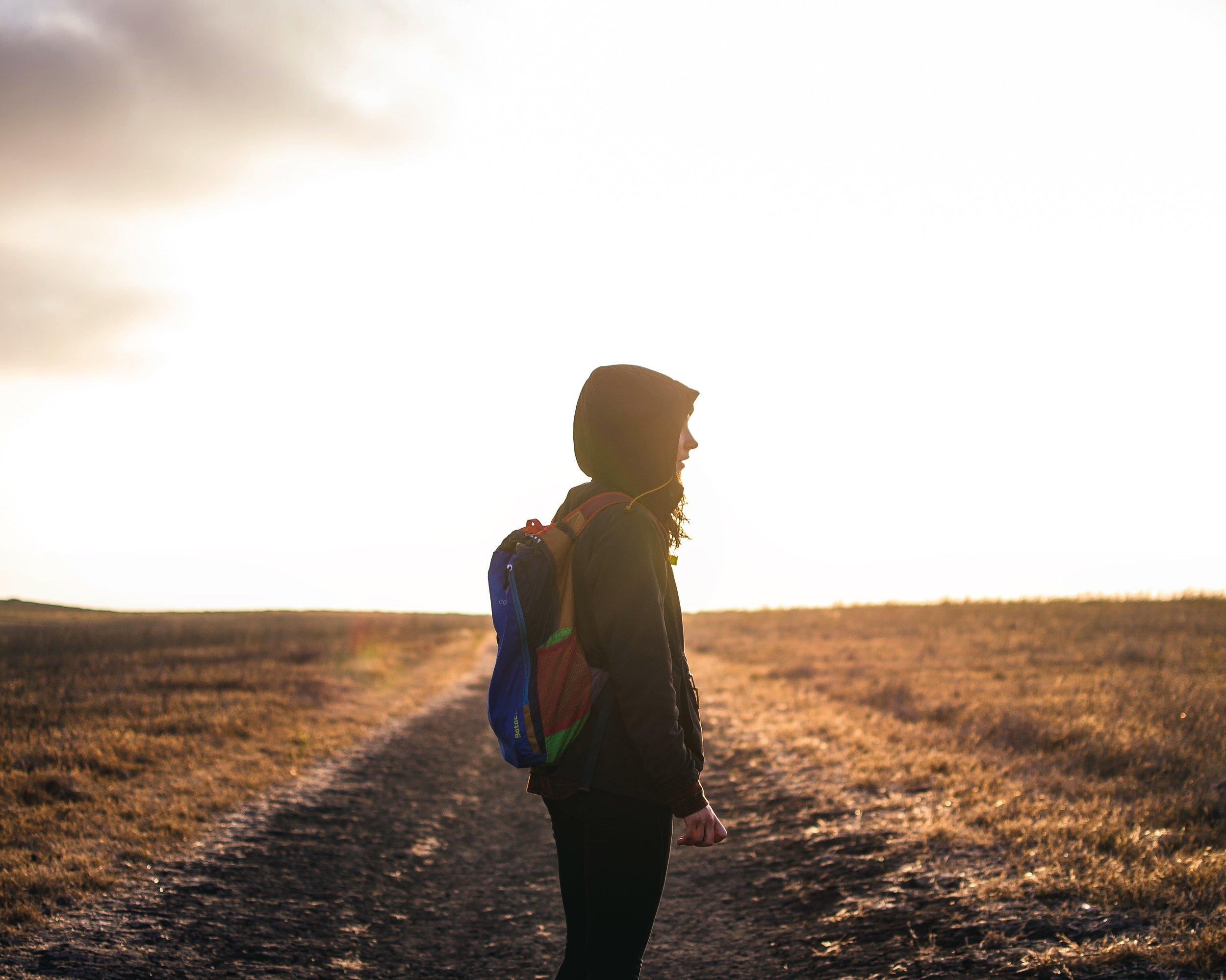 solo woman hiker in vast grassland