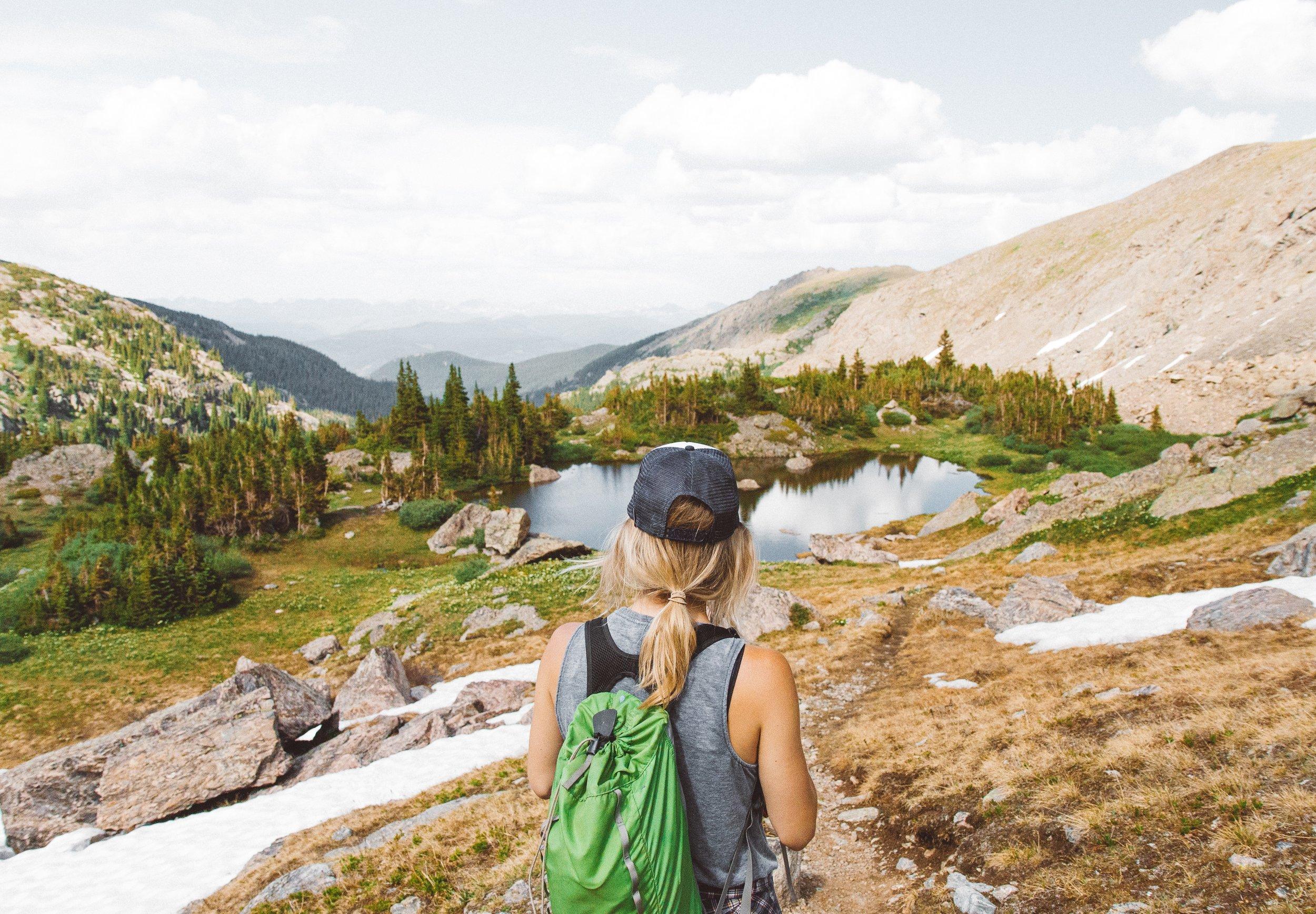 woman hiking through mountains