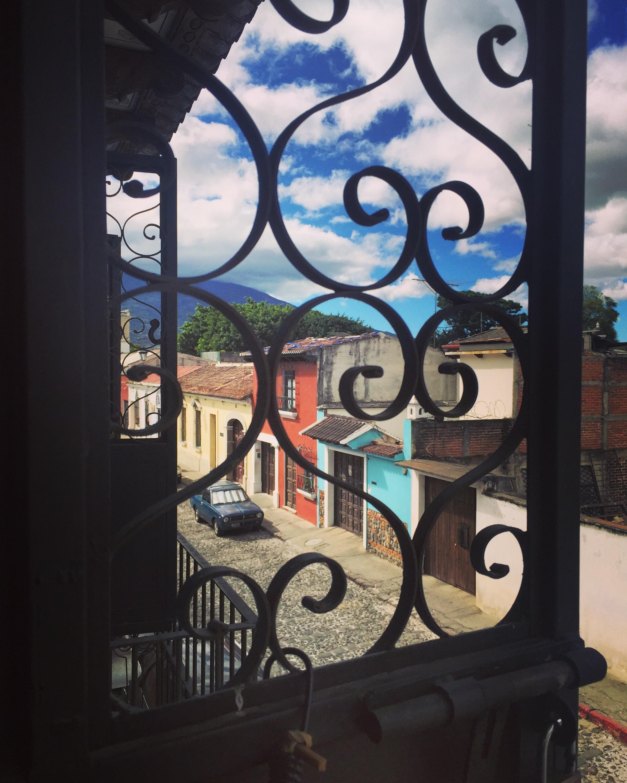 colorful houses seen through an iron window in Antigua Guatemala
