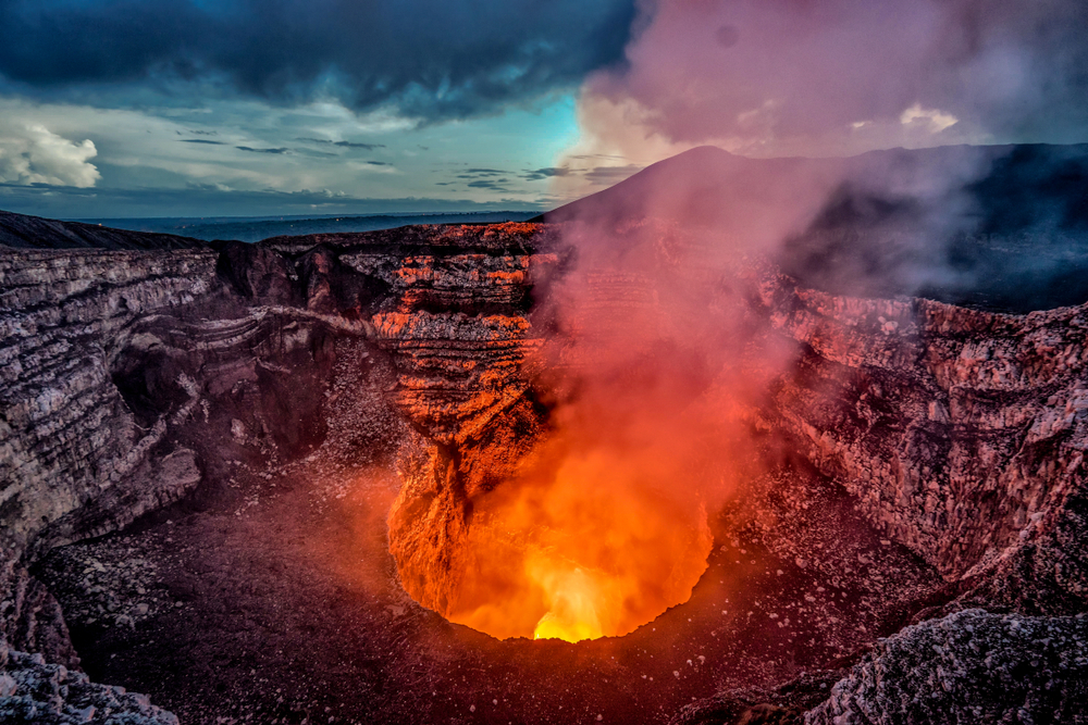 smoldering volcano with fiery lava pit