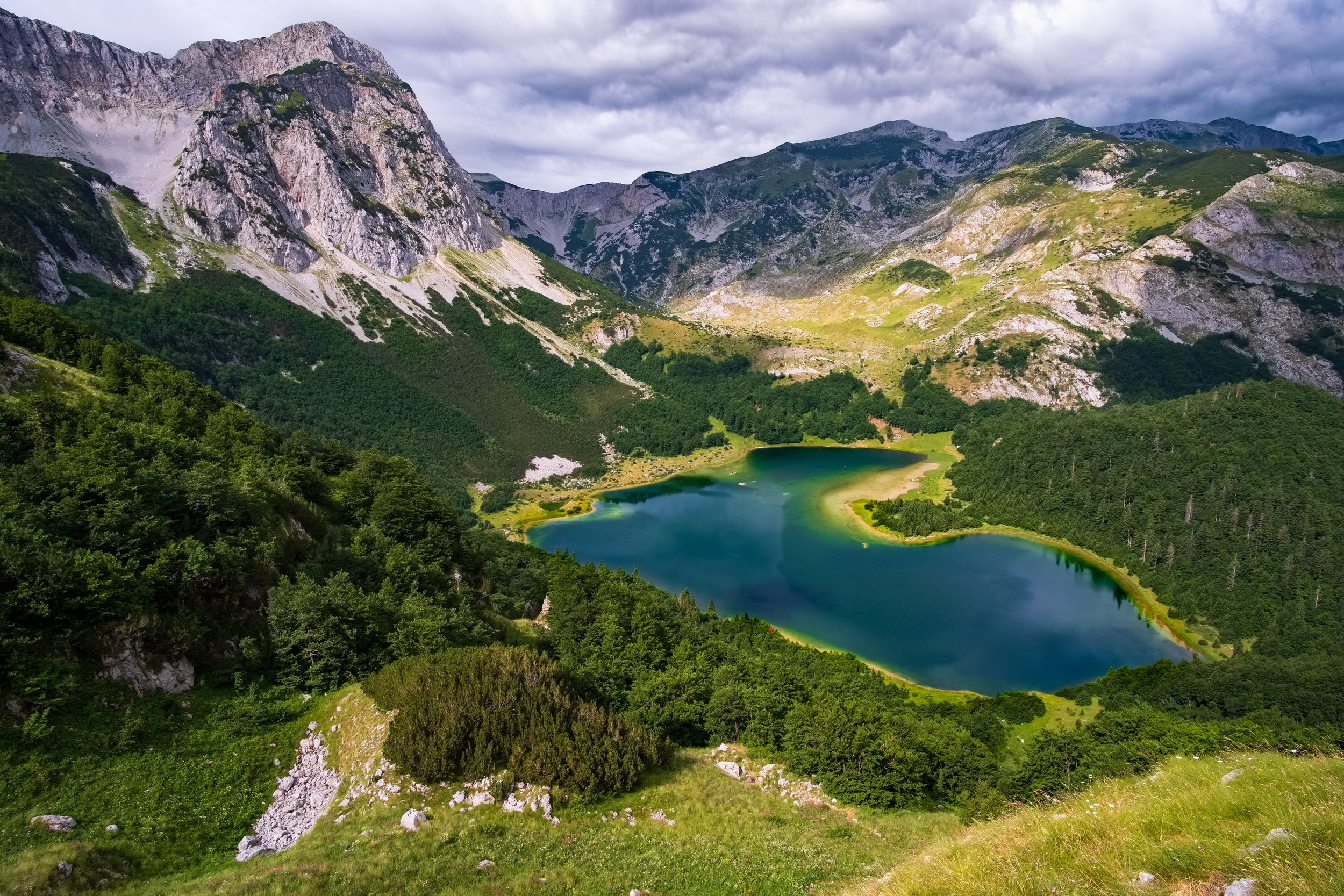 lake piva montenegro with forested mountains surrounding the water