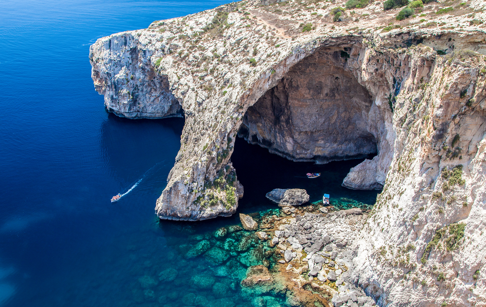 aerial view of blue grotto in montenegro with stunning cliffs jutting into the water