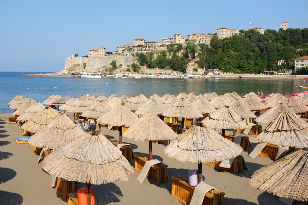 lined up umbrellas on a beach in montenegro