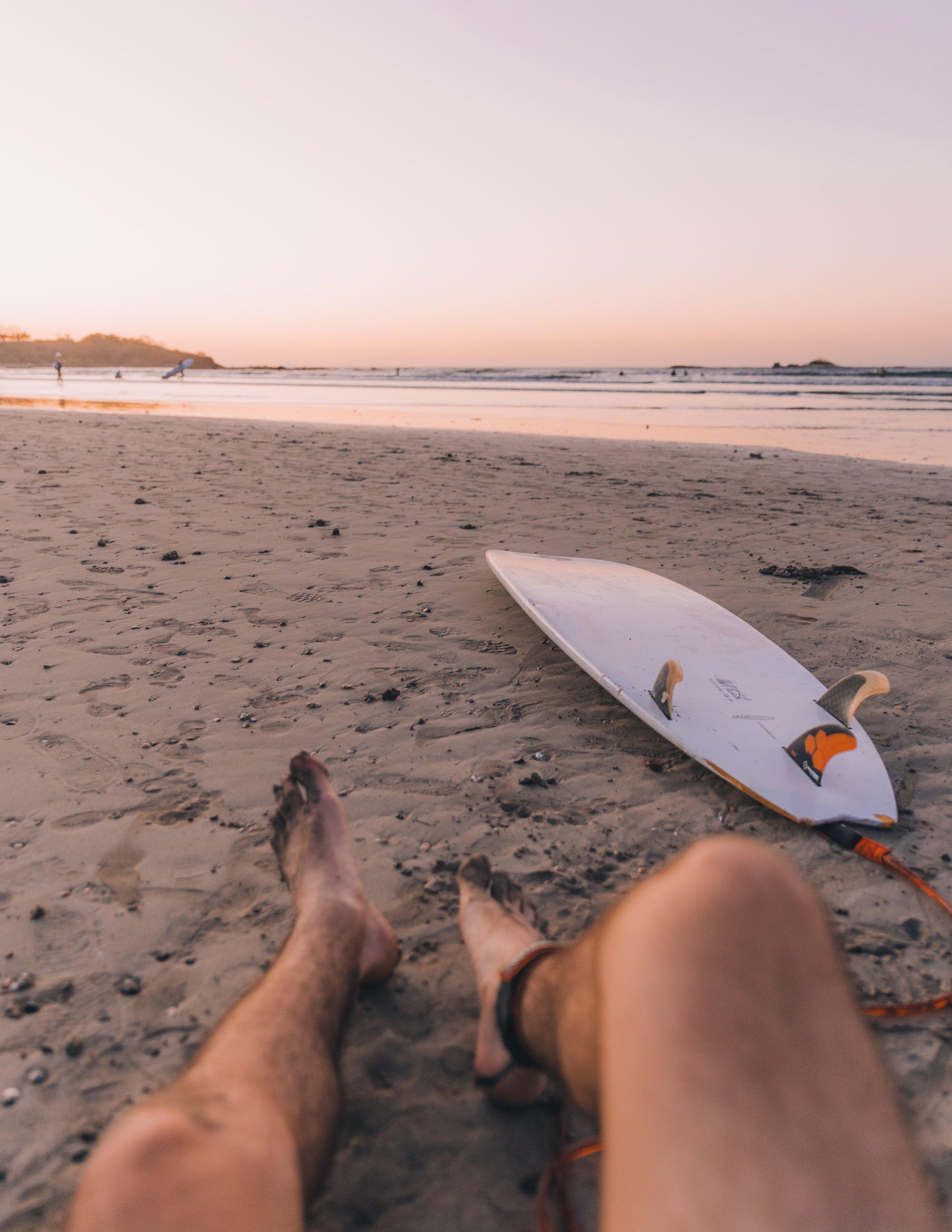 surfboard on a sandy beach