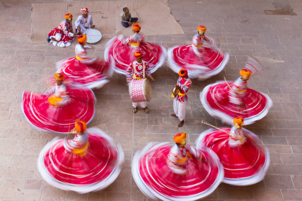 traditional indian dancers spinning around in pink colorful dress